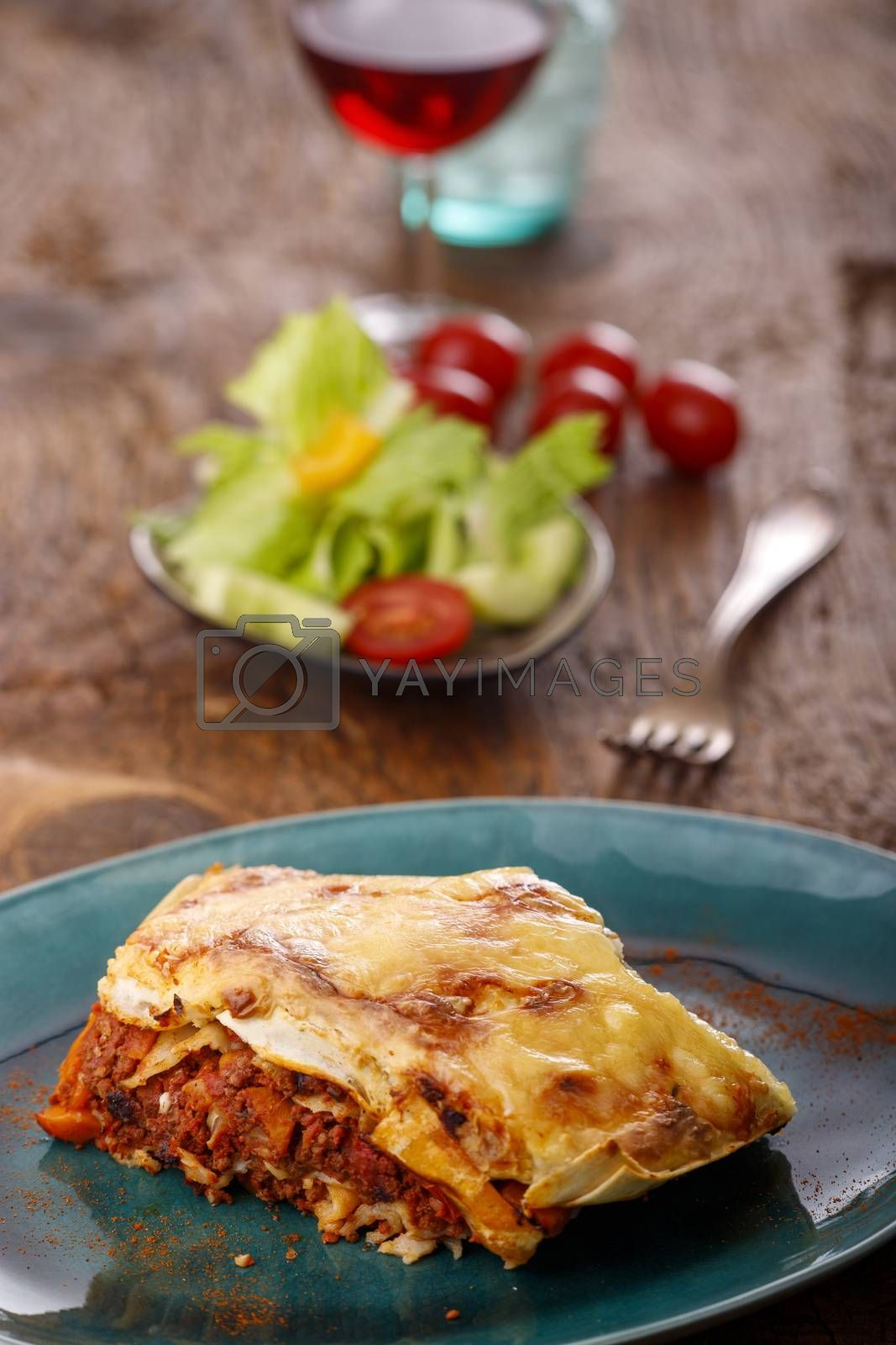 portion of italian lasagna on a blue plate