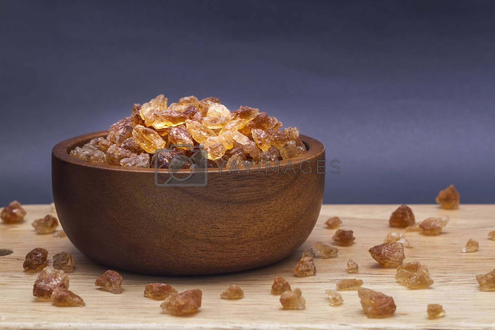Brown rock sugar in the wooden bowl