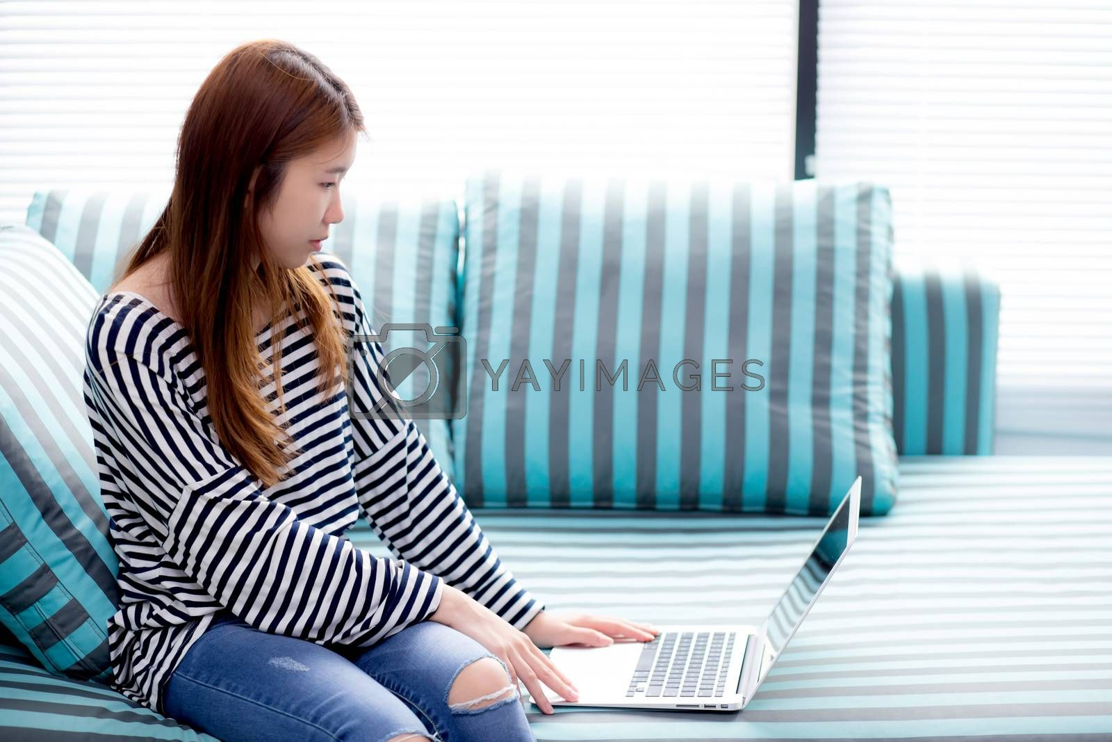 Beautiful of portrait young asian woman using laptop for leisure by nnudoo