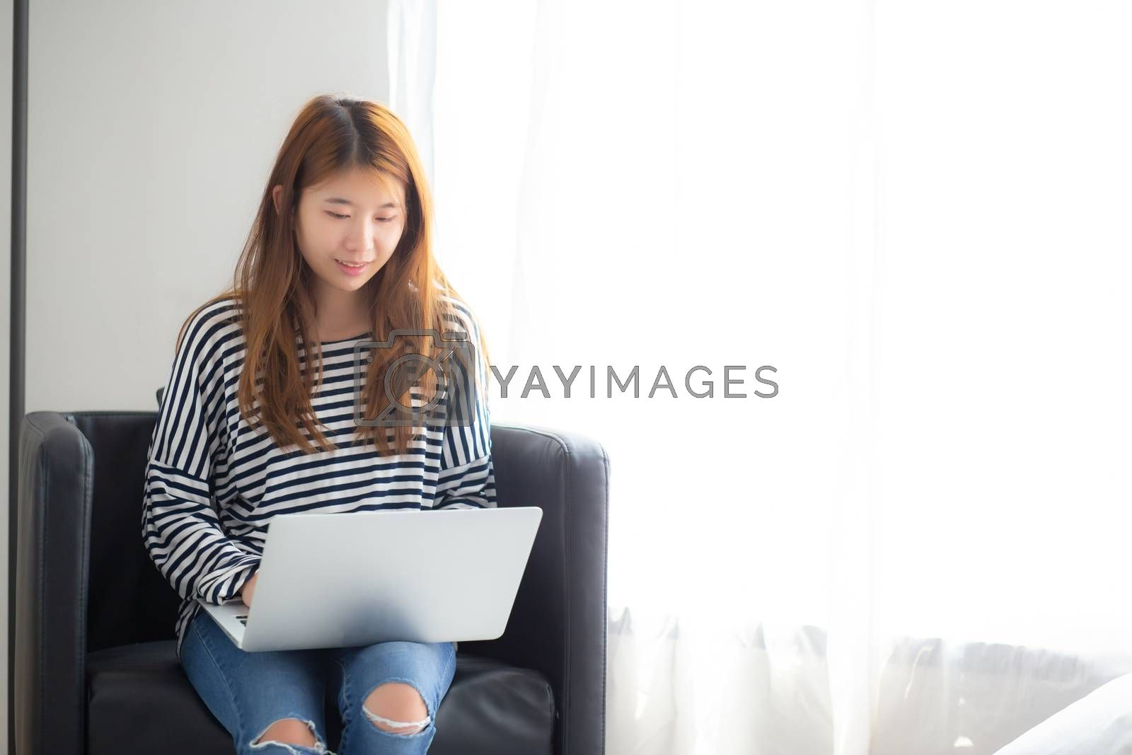 Beautiful of portrait young asian woman using laptop computer  f by nnudoo