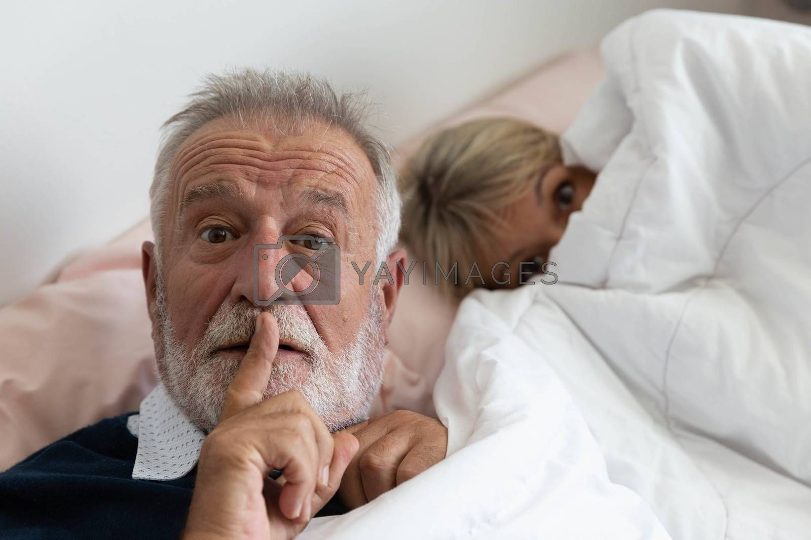 Grandfather ask to keep silence while grandmother is going to sleep