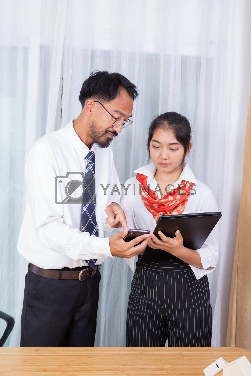 two asian male and female as business partner smile with the master plan