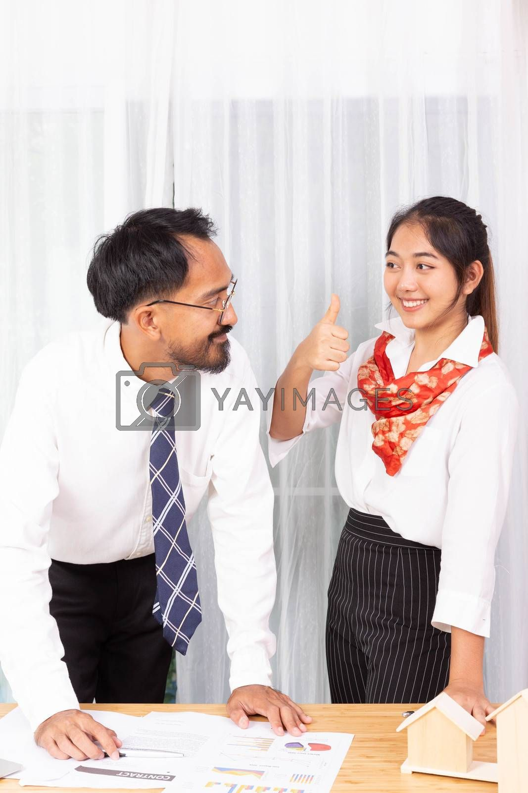 two asian male and female as business partner thumb up for the plan