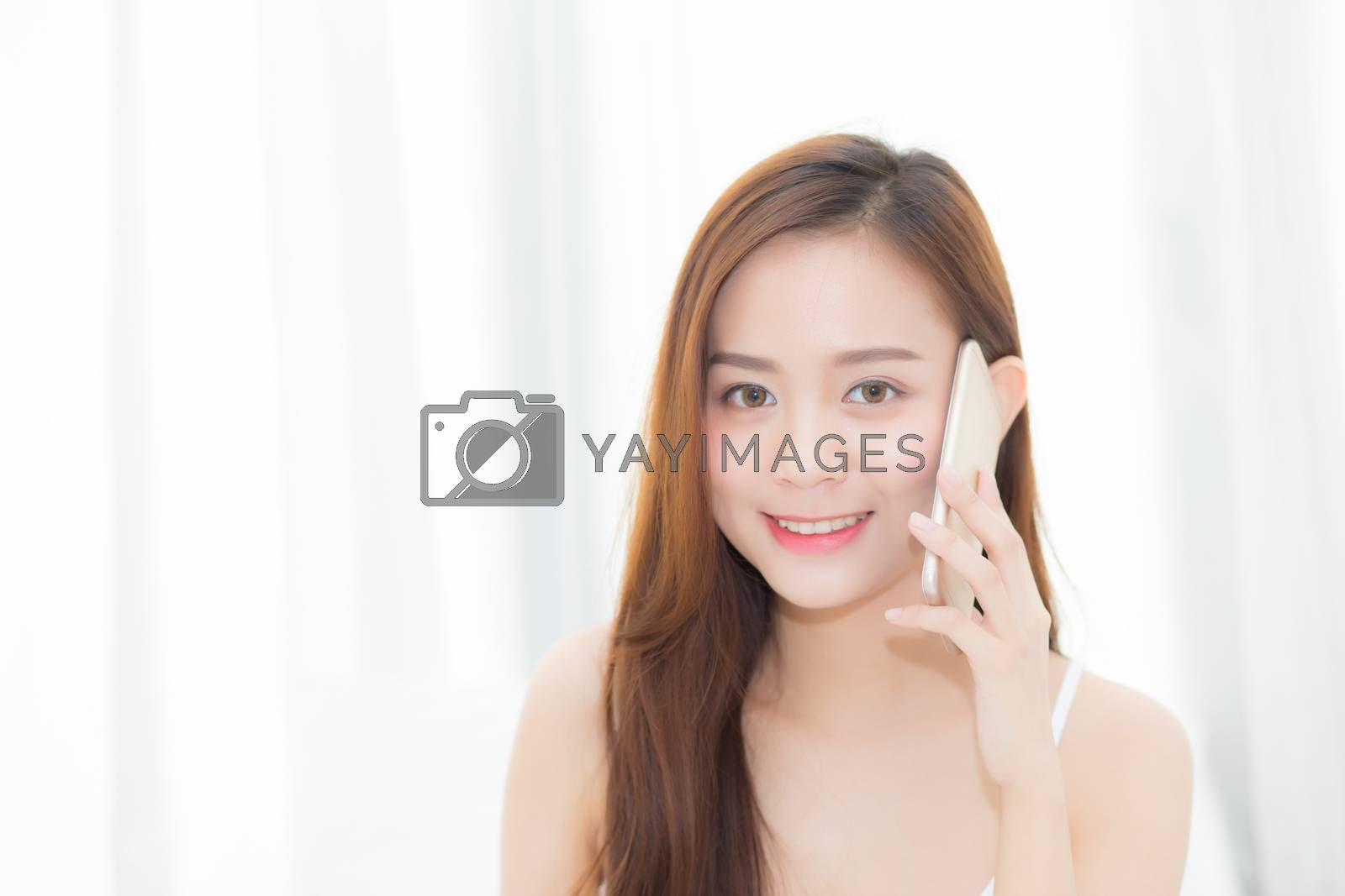 Beautiful of portrait young asian woman smiling sitting relax in by nnudoo