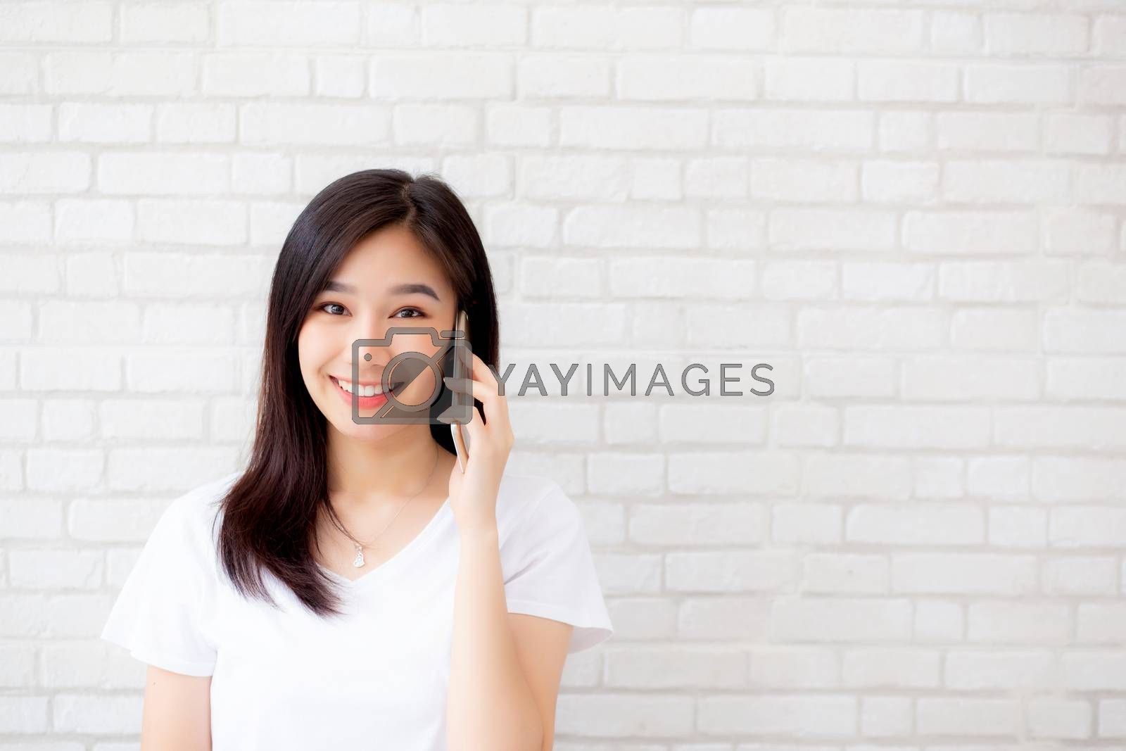 Beautiful of portrait young asian woman talk smart phone and smi by nnudoo