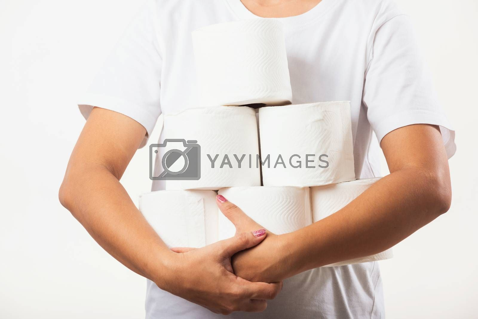 Closeup Asian young woman stocking up toilet paper for home panic in stores quarantine from coronavirus. Female holding many rolls of toilet paper in arms on chest, studio isolated on white background