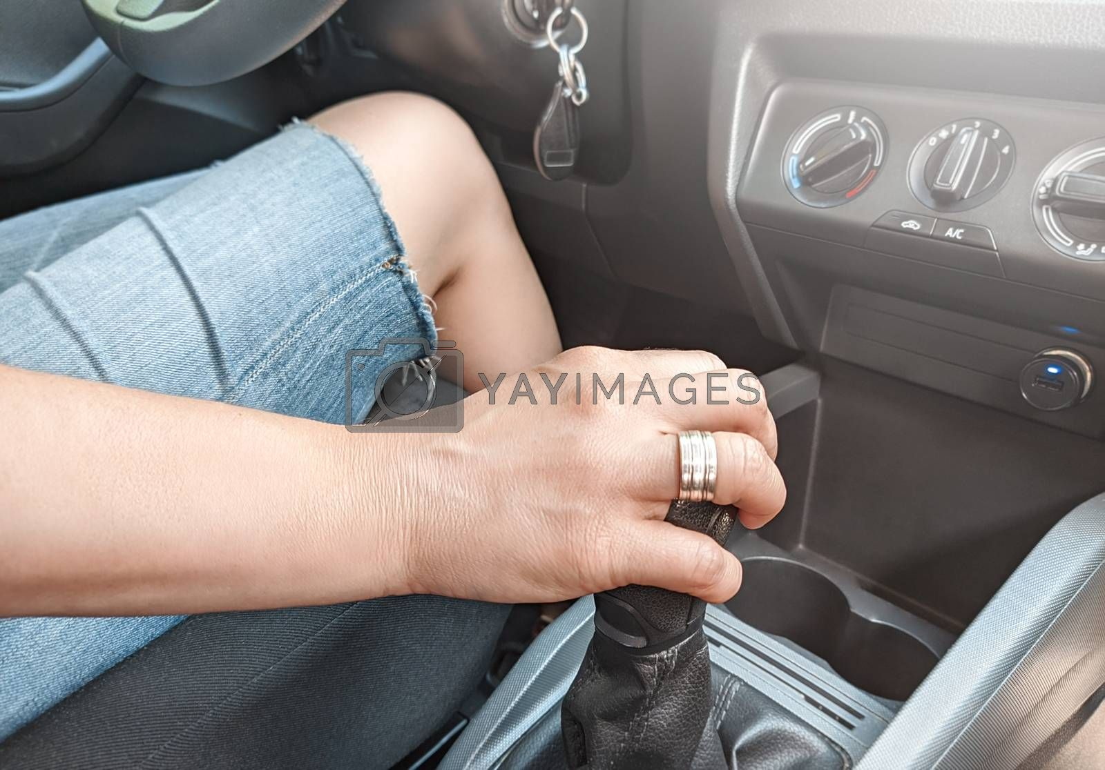 Cropped shot of a woman sitting in a car with her hand on gearbox copyspace driving learning confidence travelling transportation vehicle automotive industry.