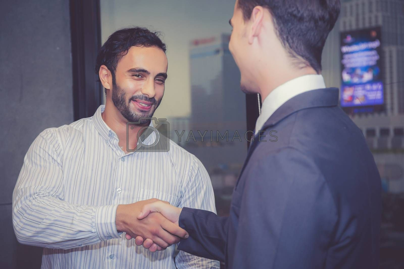 Two business man people shaking hand with success, agreement of discussion with handshake after meeting in teamwork, communication concept.