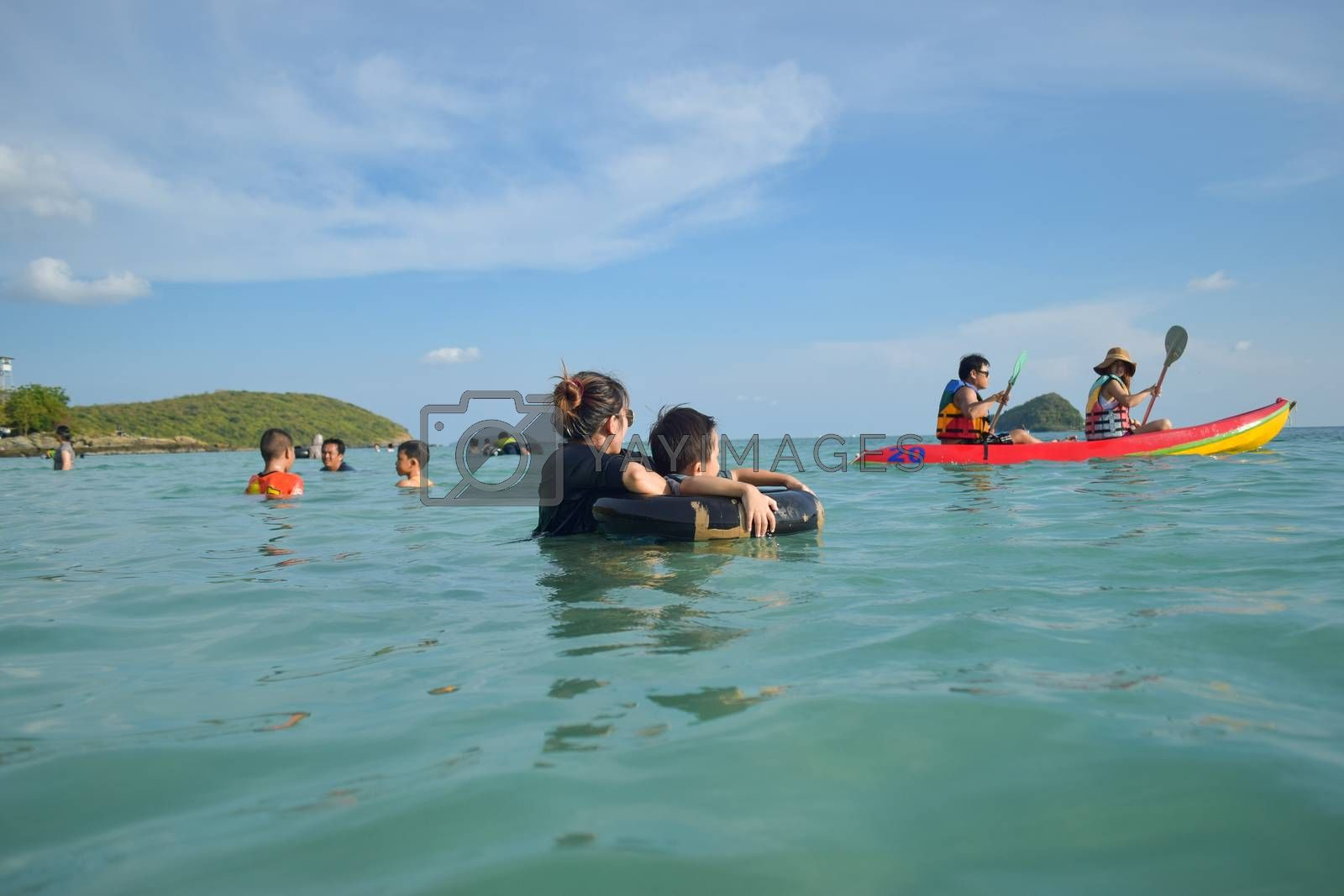 Rayong,Thailand,May5th,2014:The boys are happy and fun to see the ocean for the first time.