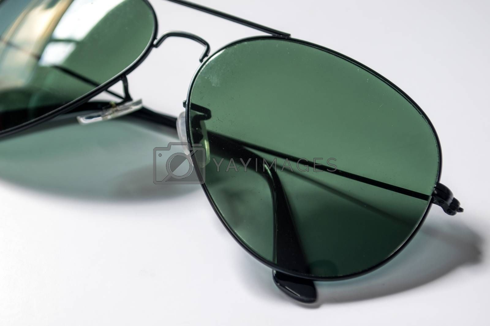 glasses tinted to protect the eyes from sunlight or glare.