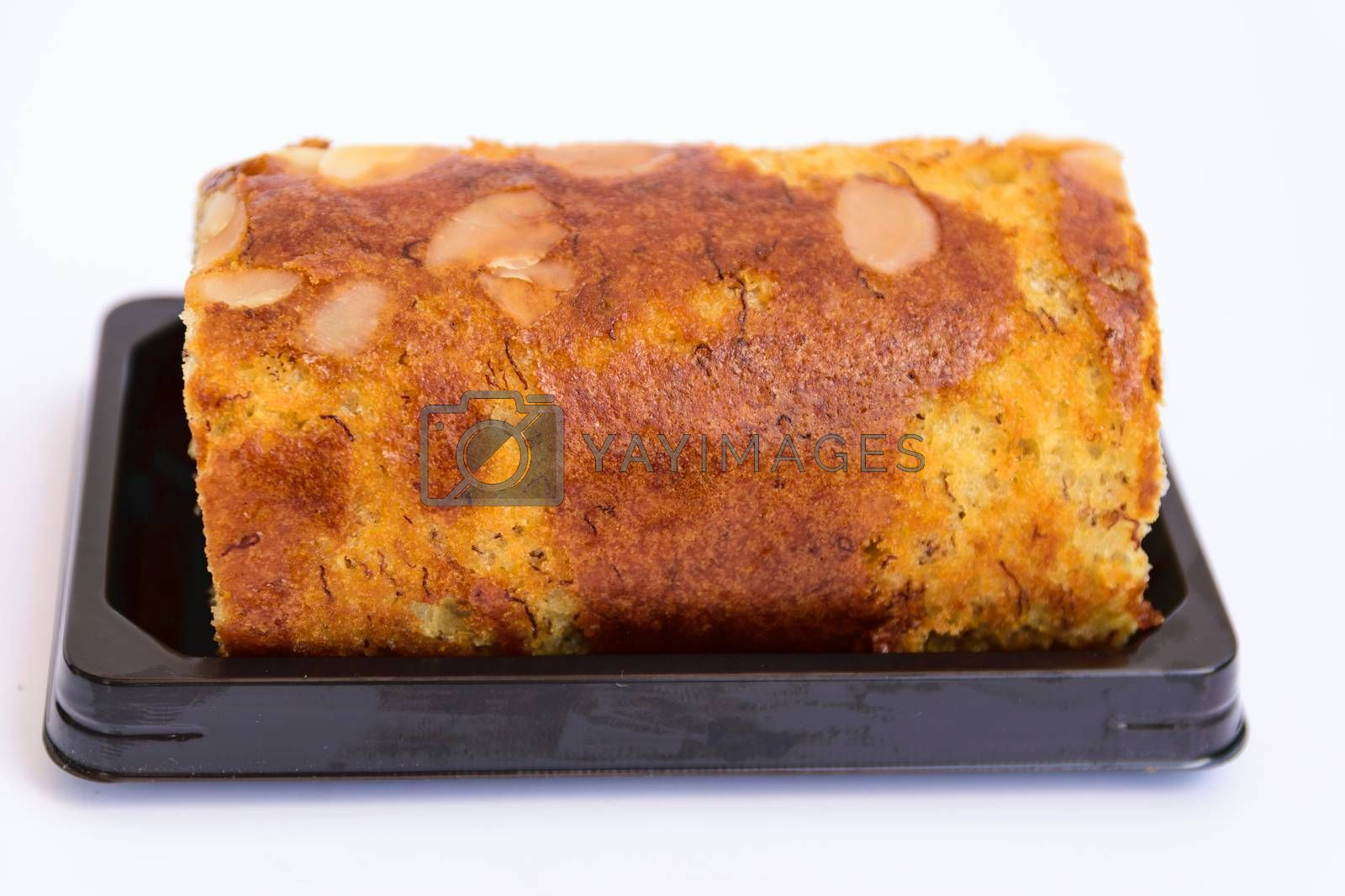 A small sweet cake, typically round, flat, and crisp.