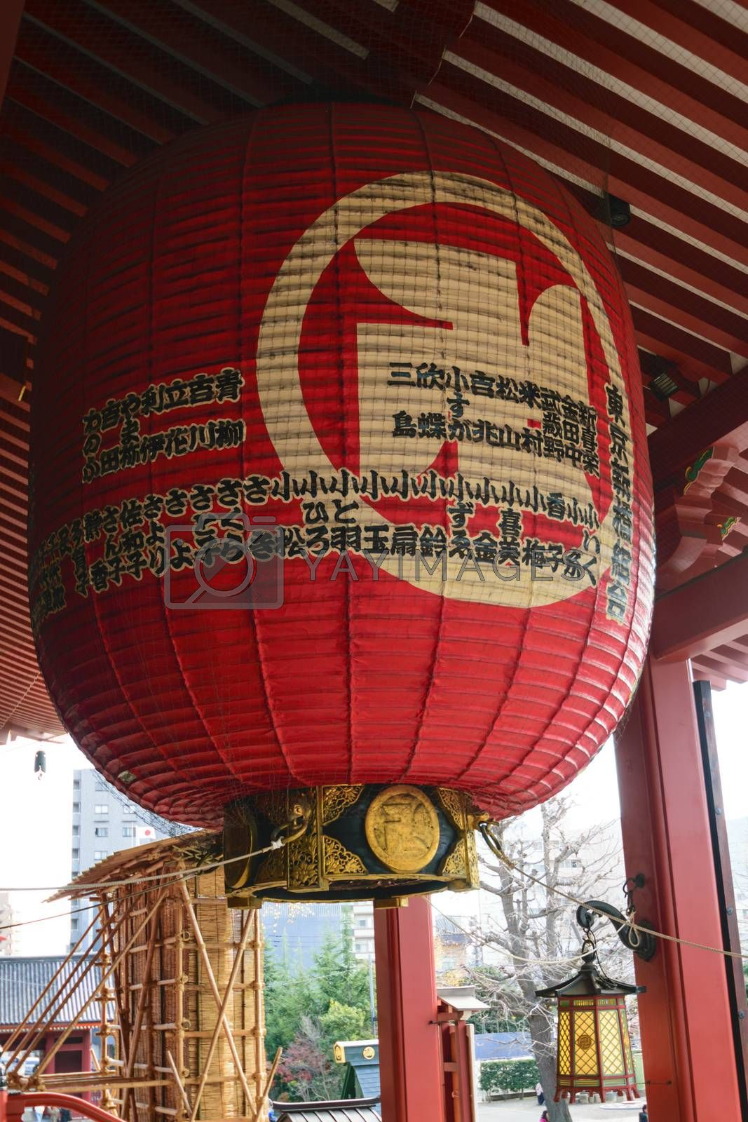 Ancient giant Japanese lantern in a beautiful Asakusa Temple in a claer day in Japan.