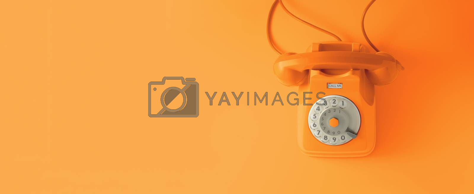 Royalty free image of An orange vintage dial telephone. by maramade