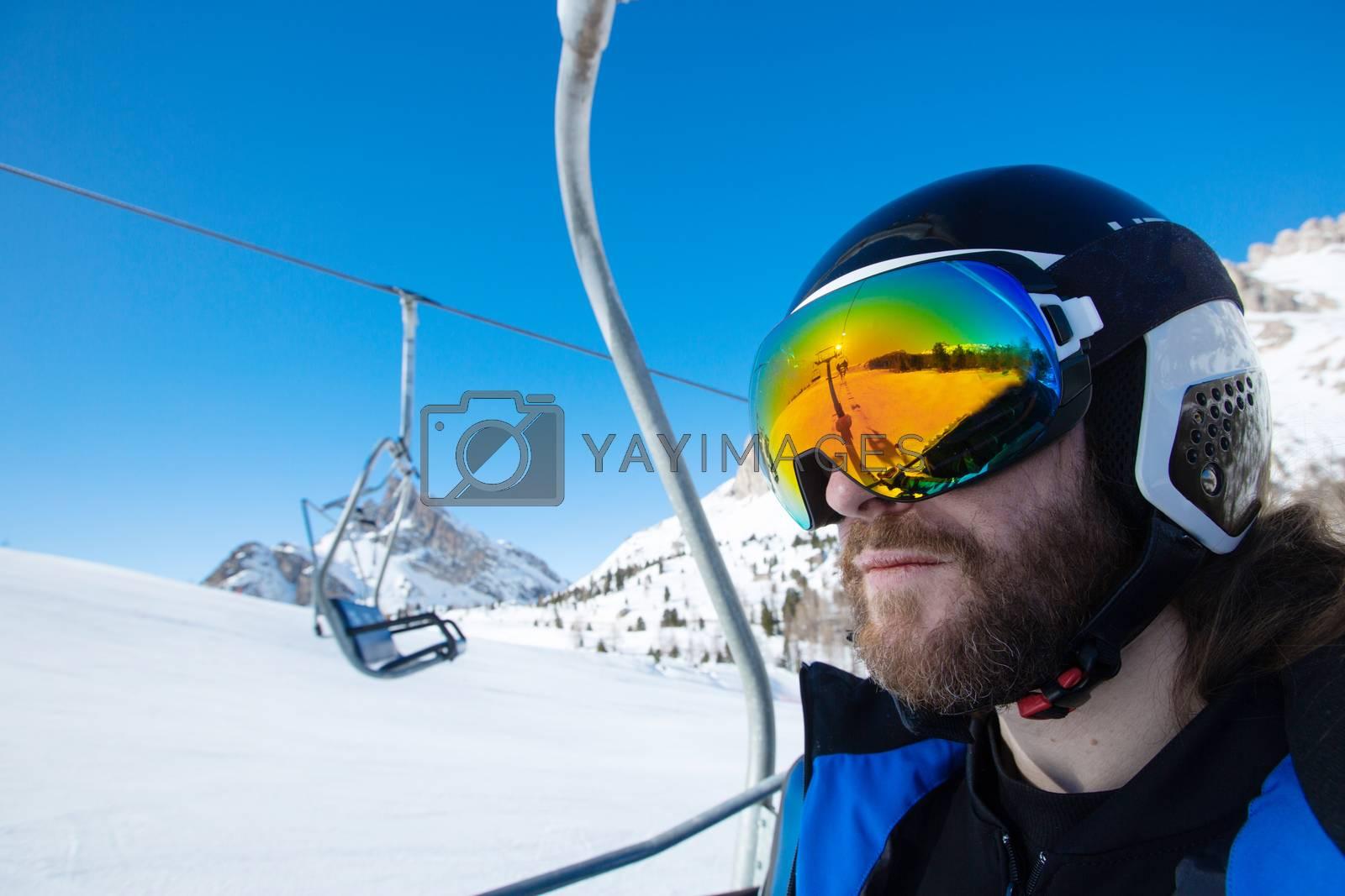 Royalty free image of Man skier sitting in ski lift by destillat