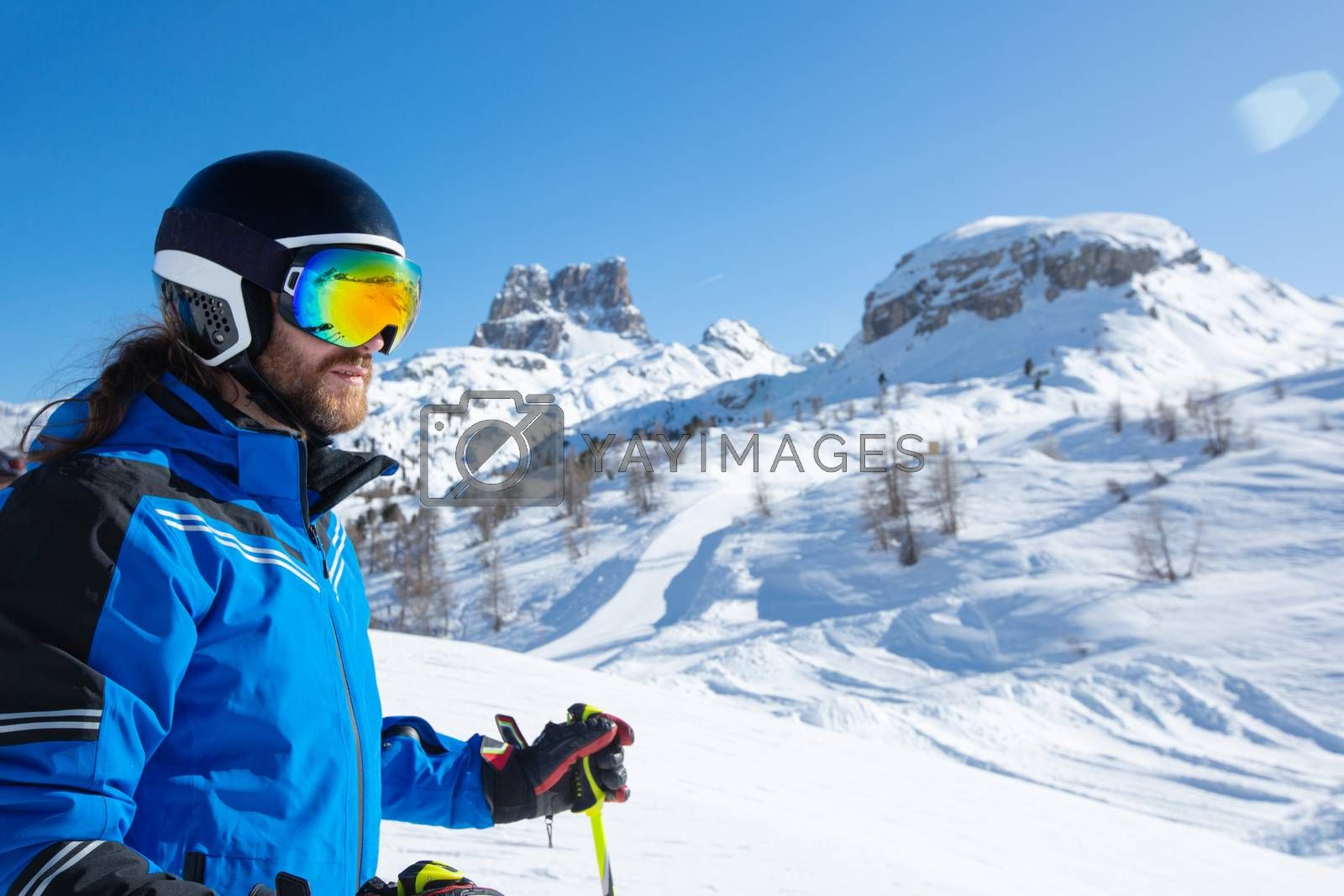 Royalty free image of Skier stand on slope in winter mountains by destillat