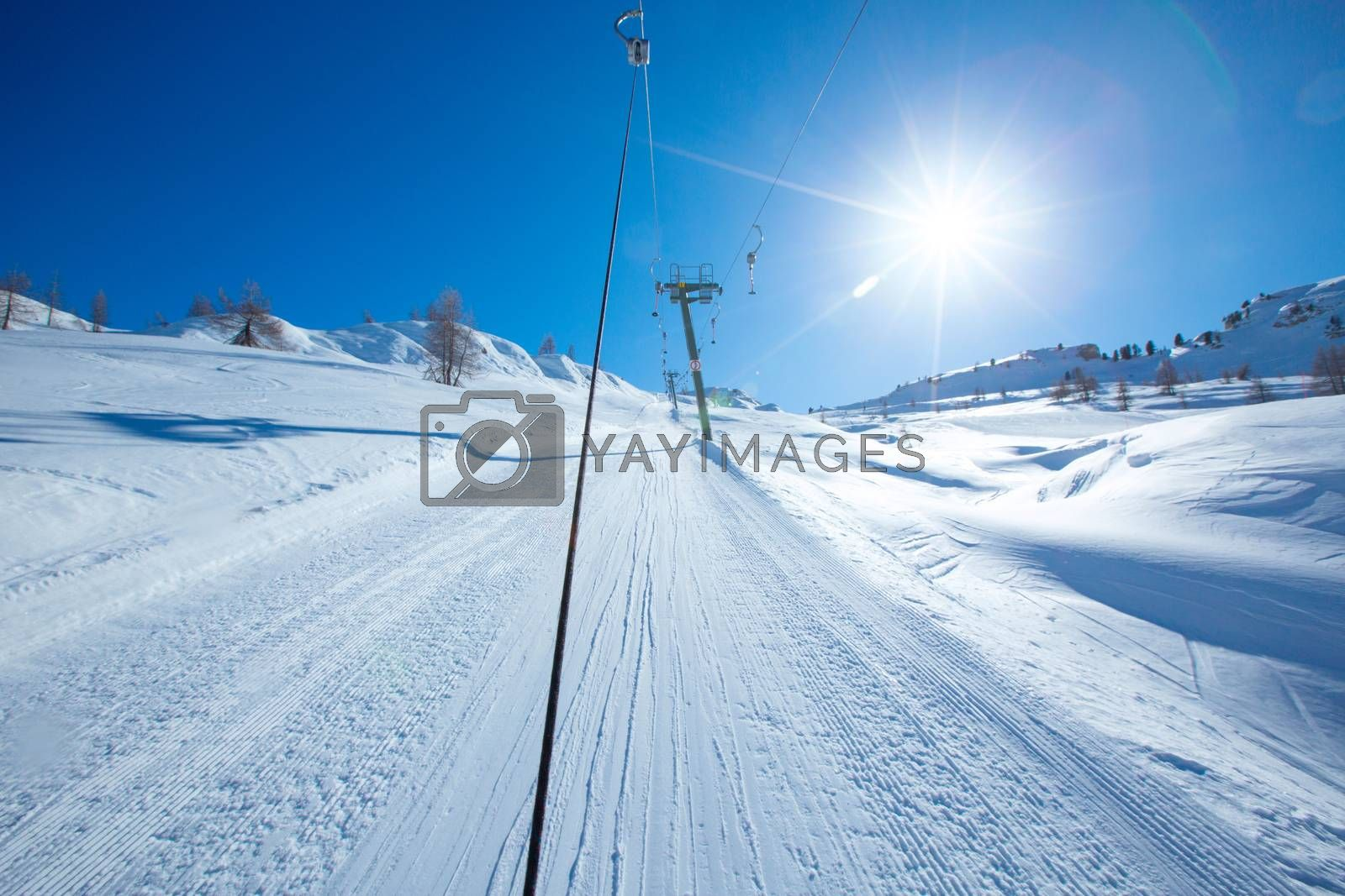 T bar ski lift for pulling skiers up the slope. Perfect winter landscape in European Alps Italy Cortina d'Ampezzo Col Gallina