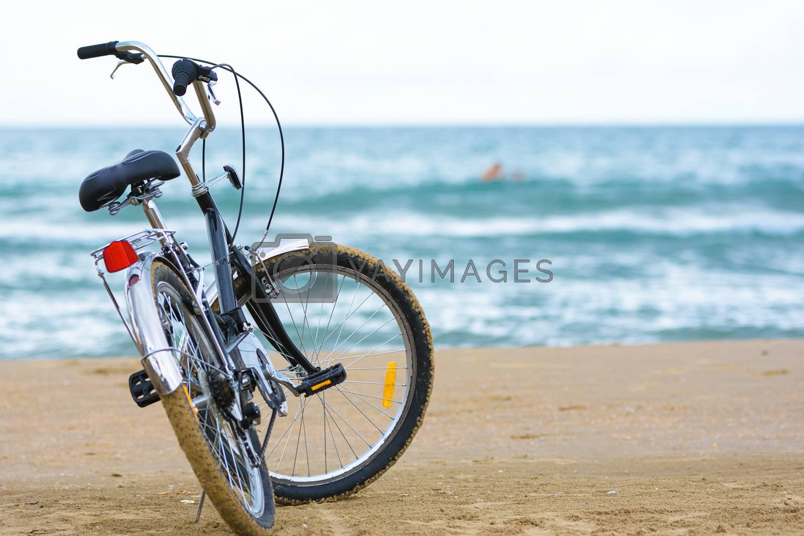 Close-up bike stands on the sea coast