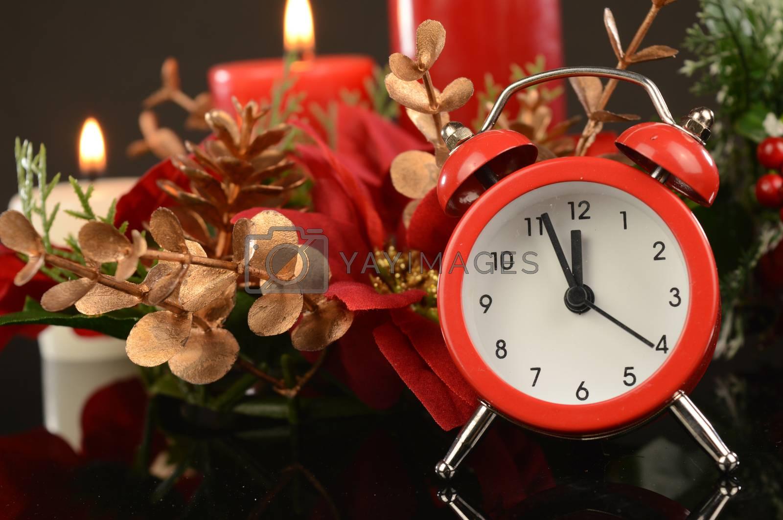 A festive scene with an alarm clock for the Christmas season.