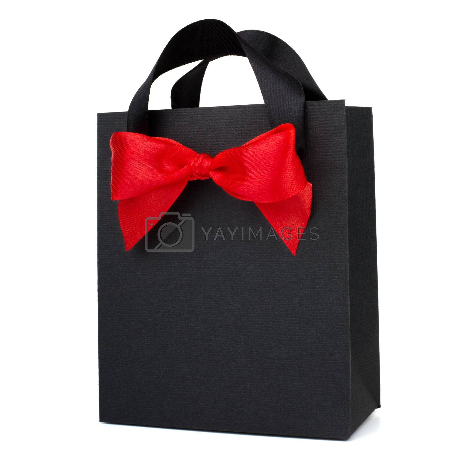 Black Friday paper bag with red ribbon bow isolated on white background sale concept