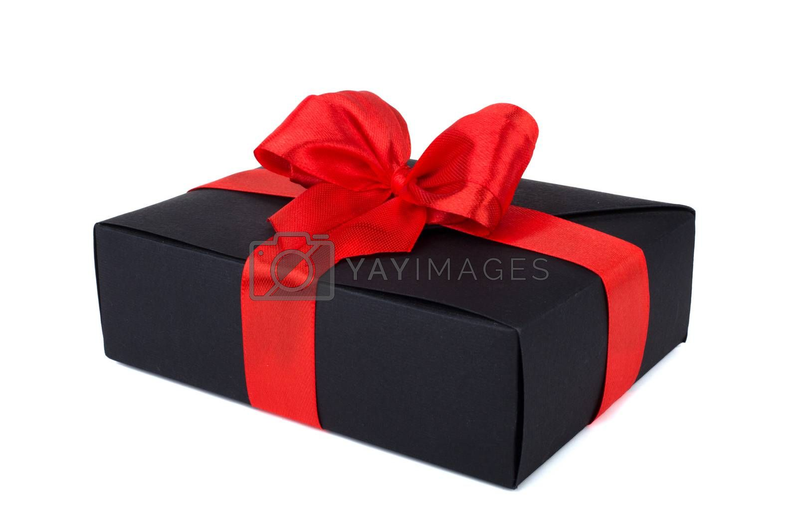 Black friday gift, paper box with red silk ribbon bow isolated on white background