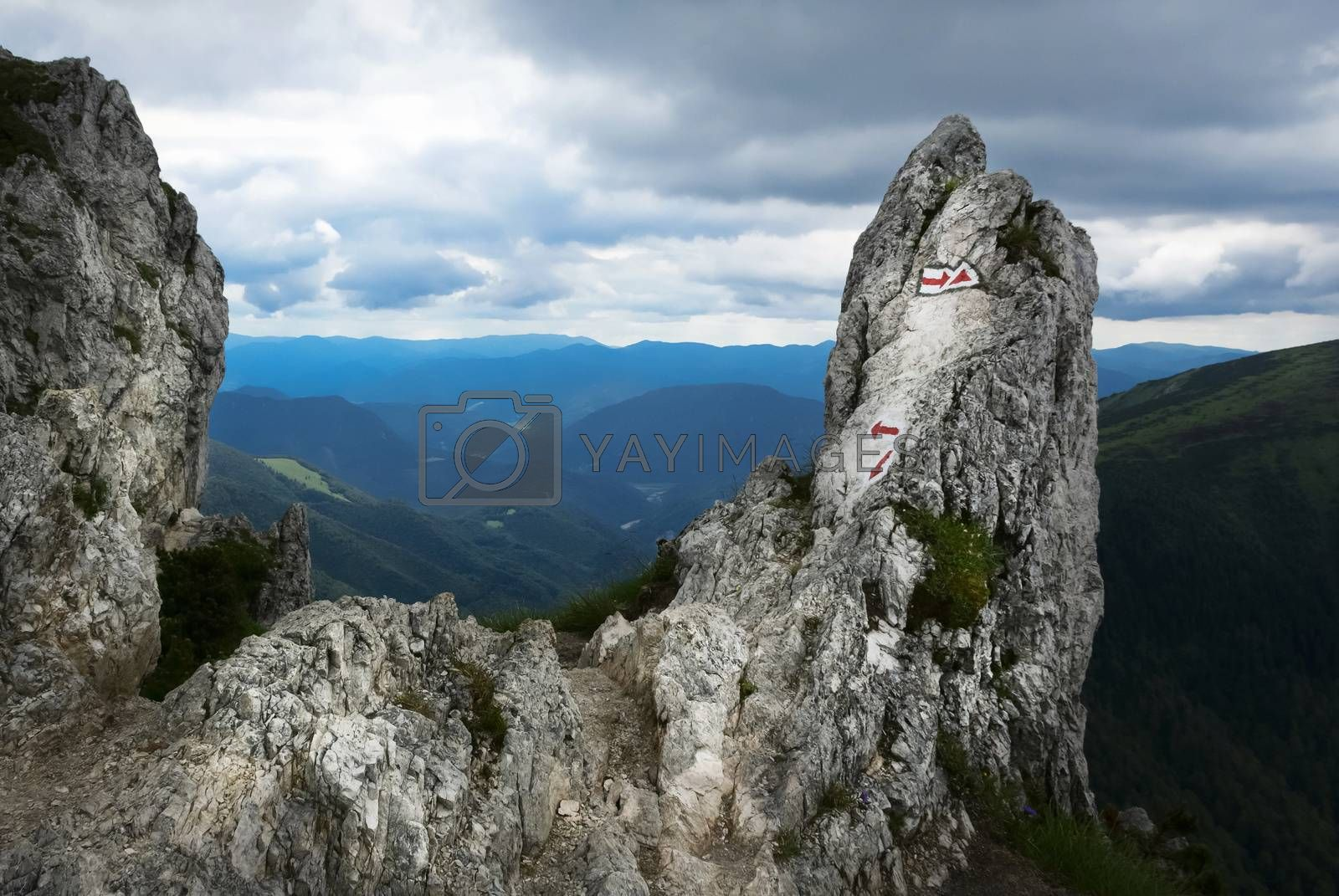 landscape background of red hiking signs on a rock