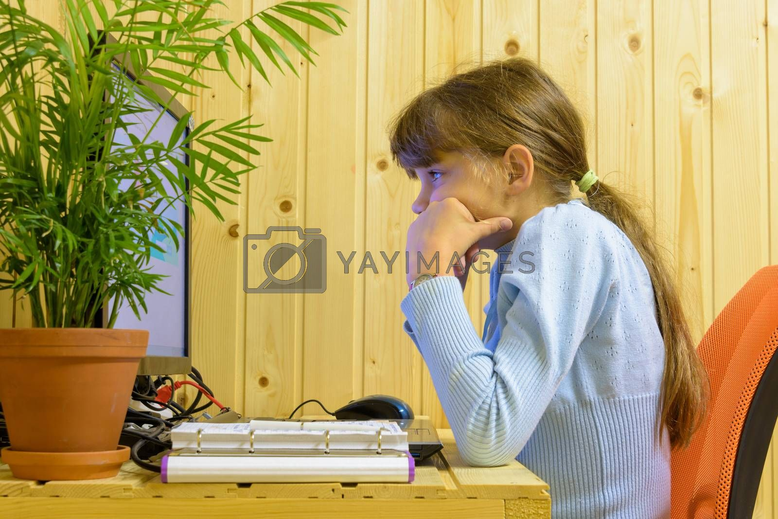 The girl thought hard while solving a problem in the computer