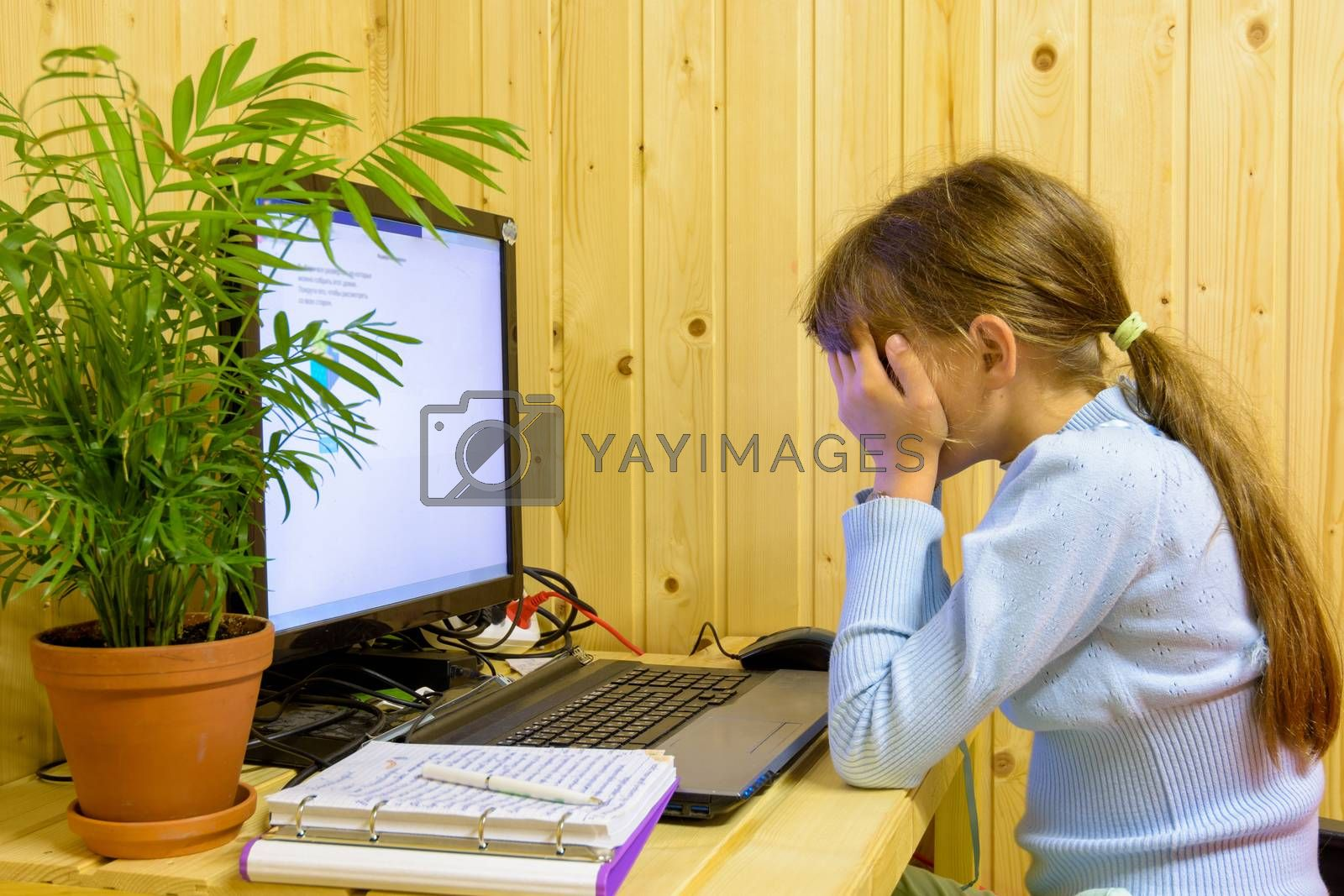 The girl closed her eyes from the fatigue of distance learning