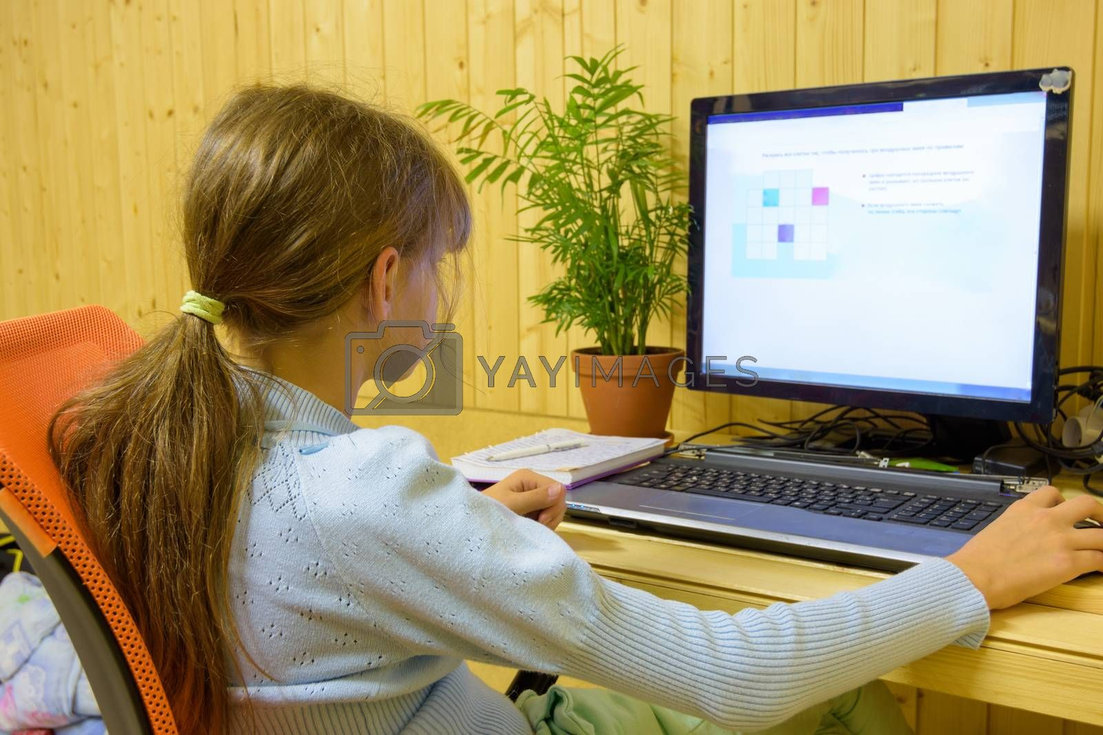 A student passes distance learning tasks on a computer