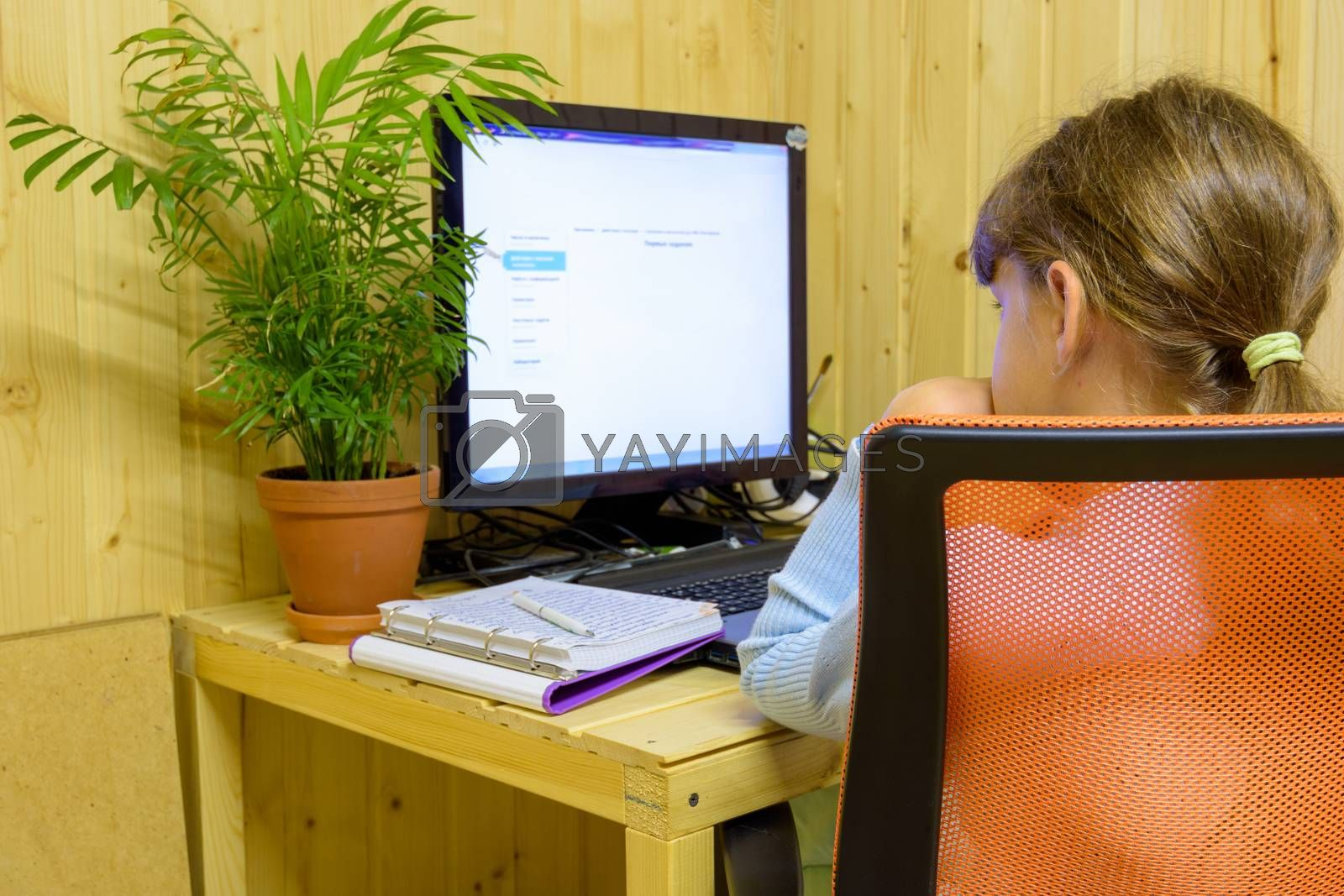 A student learns lessons in a computer with online distance learning