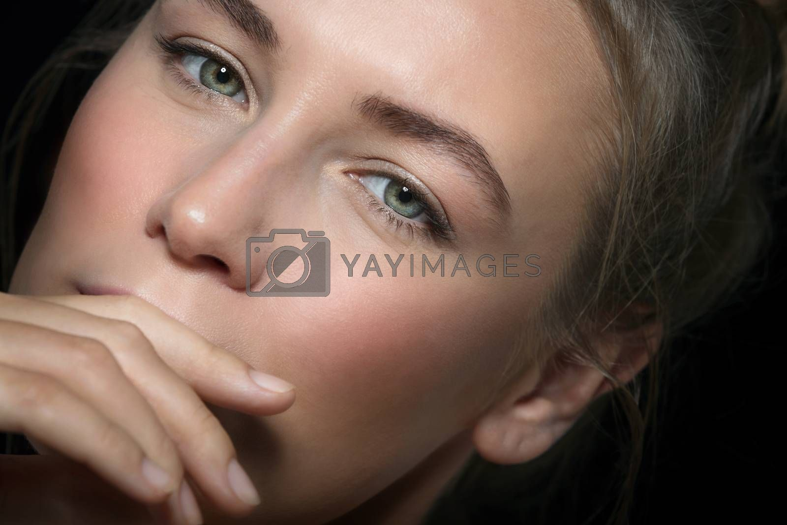 Closeup Authentic Portrait of a Nice Female with Perfect Skin. Natural Makeup. Fashion Look. Beauty and Style Concept.