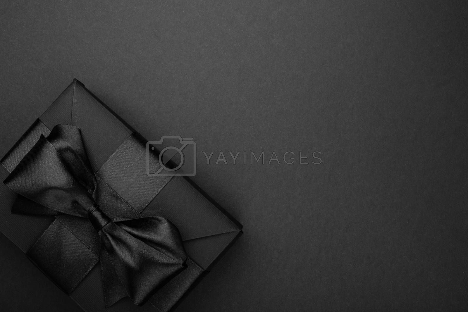 Black friday sale background with box gift present with satin ribbon bow copy space for text