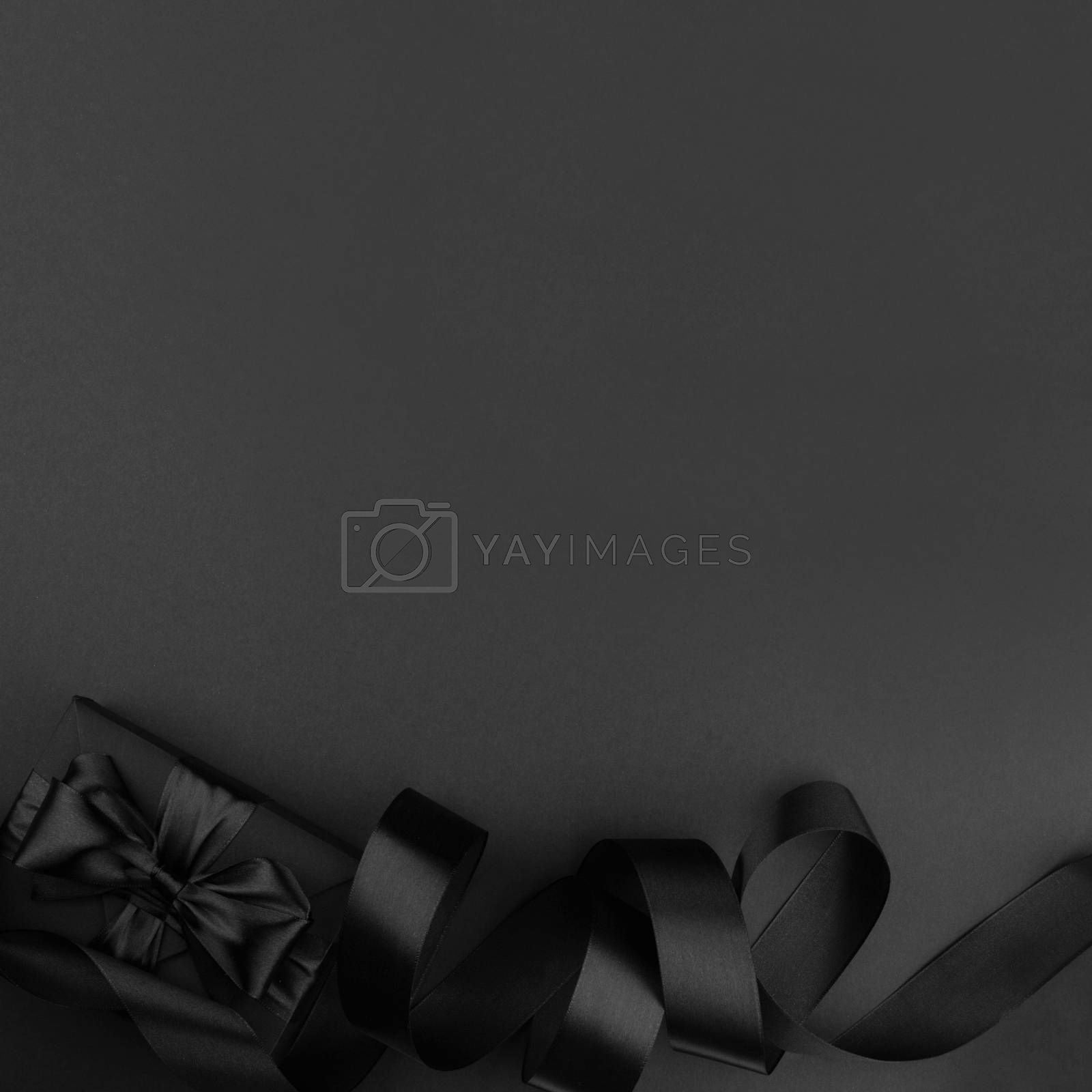 Black friday sale background with gift present box and curly ribbon with copy space for text ad