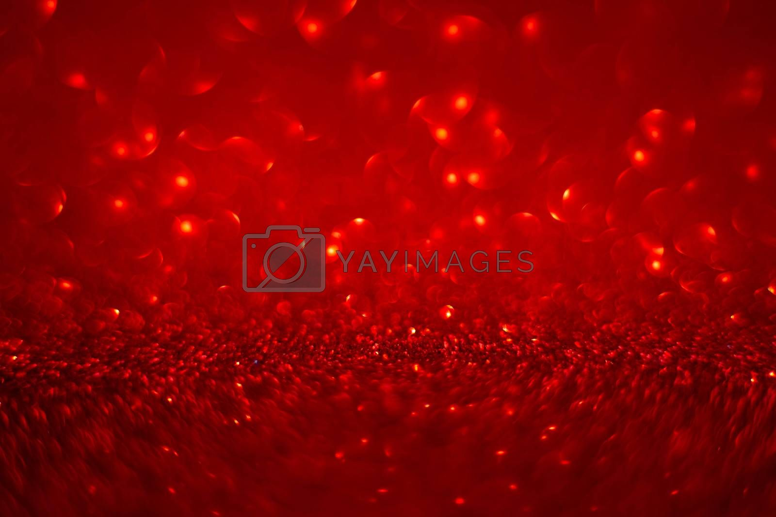Abstract red holiday background with bokeh defocused lights with copy space for text Christmas Valentines day