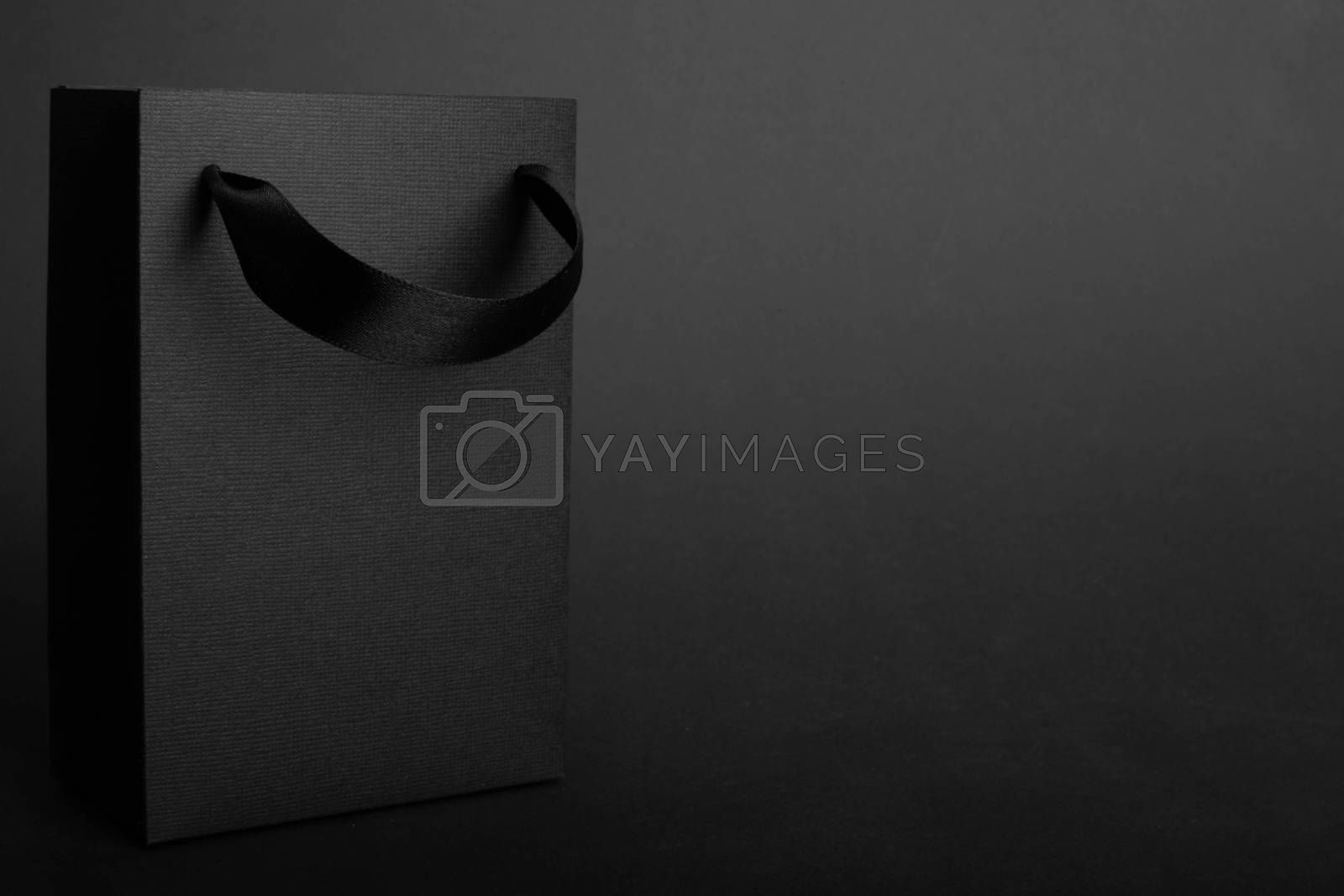 Black Friday blank empty paper bag with copy space for text and logo on dark background sale concept