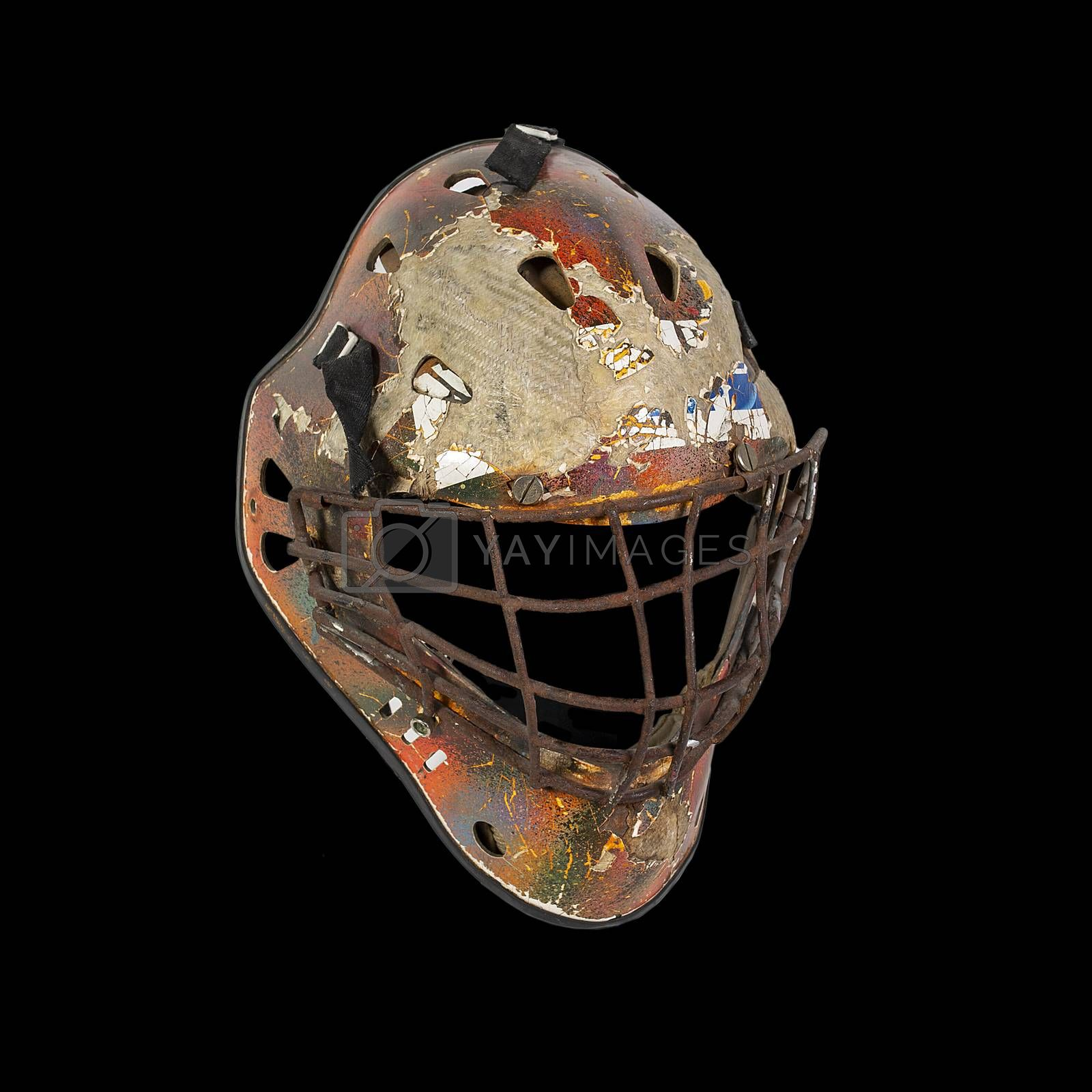 Old hockey mask for goalkeeper protection isolated on black background
