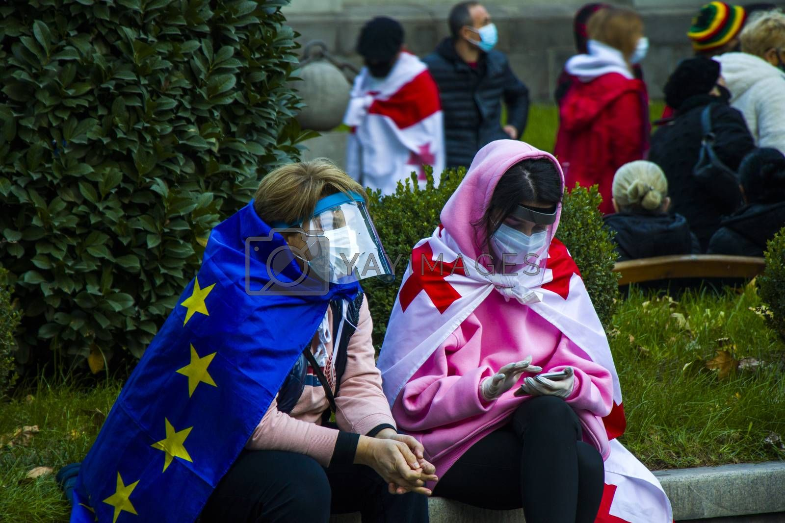 TBILISI, GEORGIA - November 08, 2020: Georgian protests in front of the Parliament of Georgia, anti-government protests after elections. People with medical face masks.
