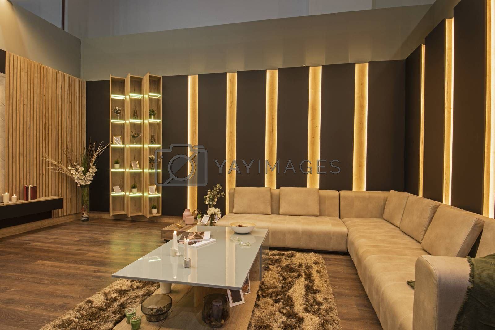 Living room lounge area in luxury apartment show home showing interior design decor furnishing with large sofa