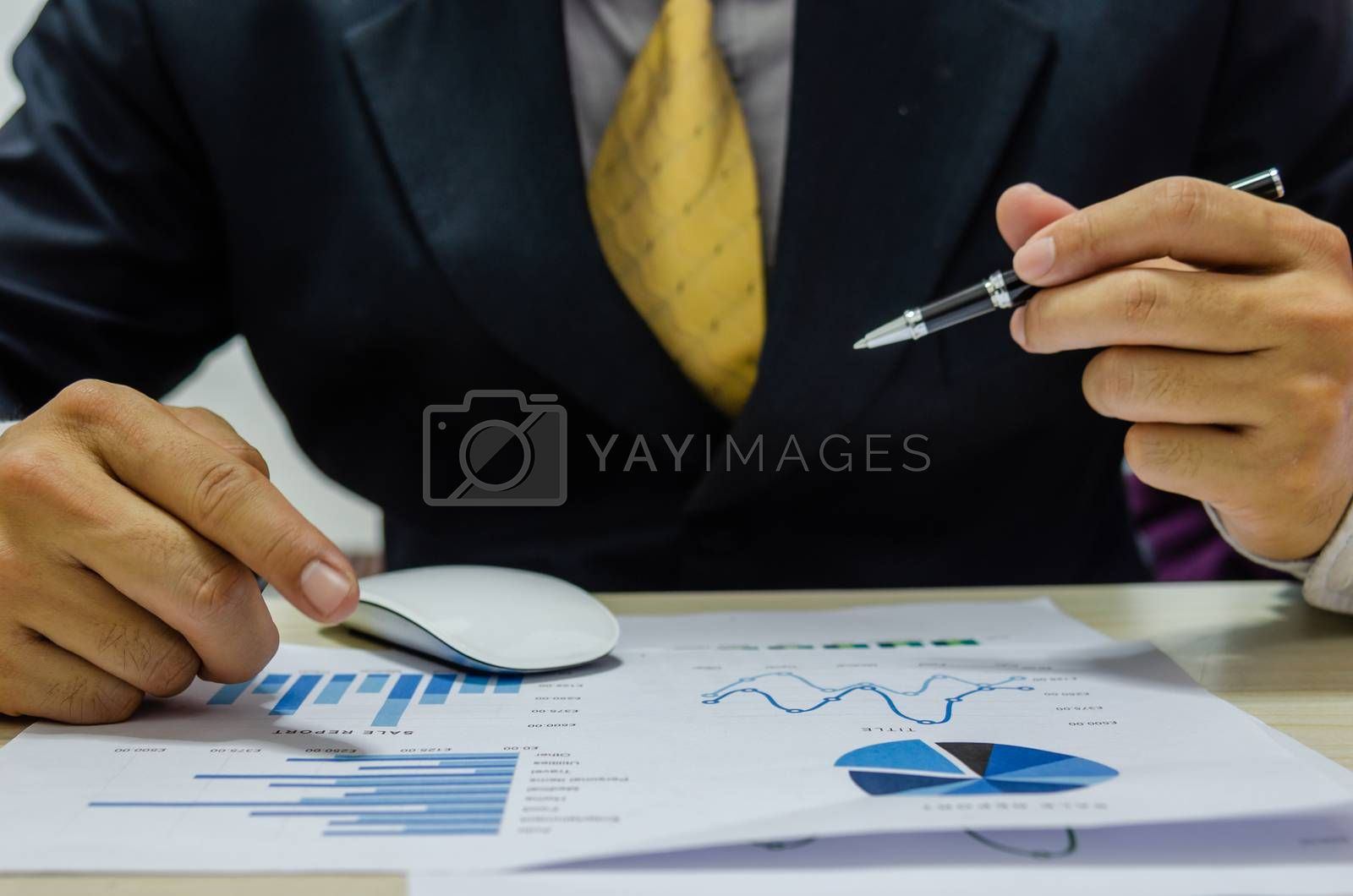 Financial business man document graph analyzing and checking income-expenses. Business concept of tax and finance.