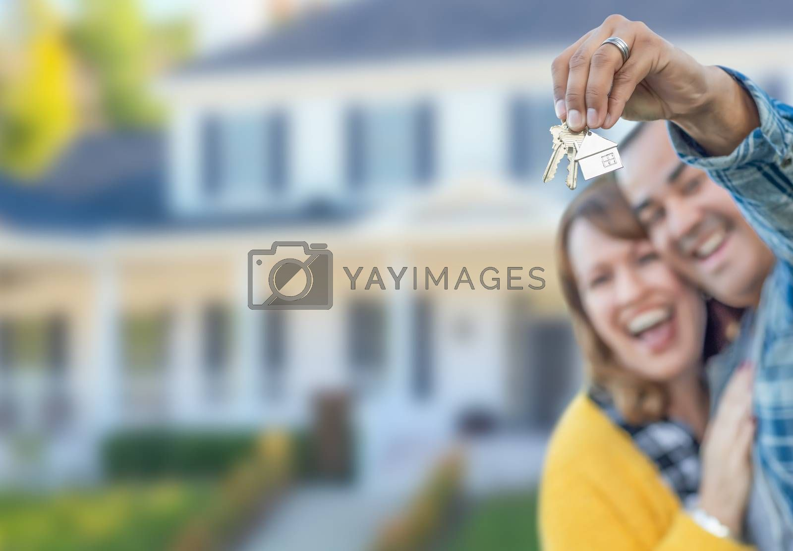 Mixed Race Couple in Front of House with Keys.