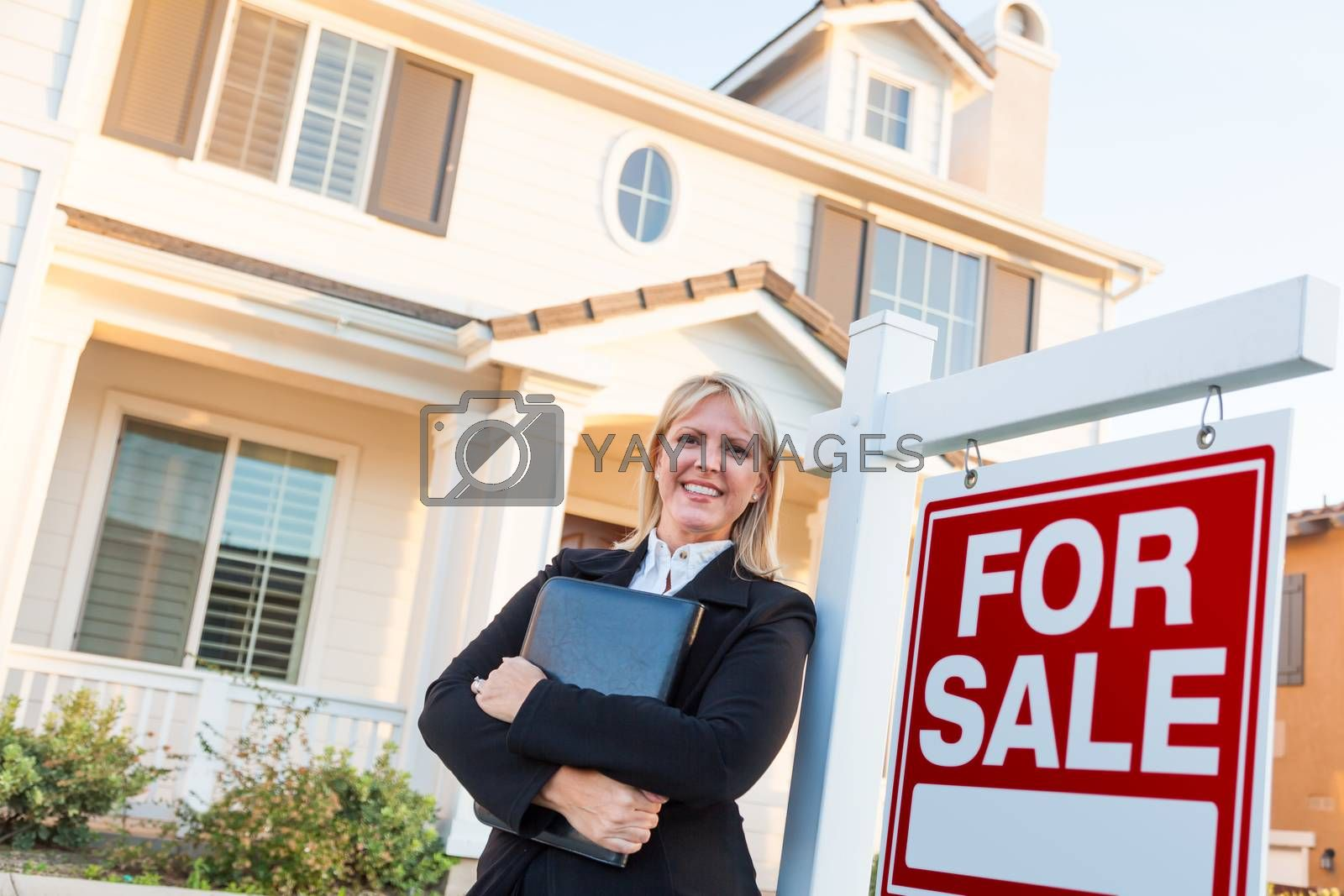 Female Real Estate Agent in Front of For Sale Sign and Beautiful by Feverpitched