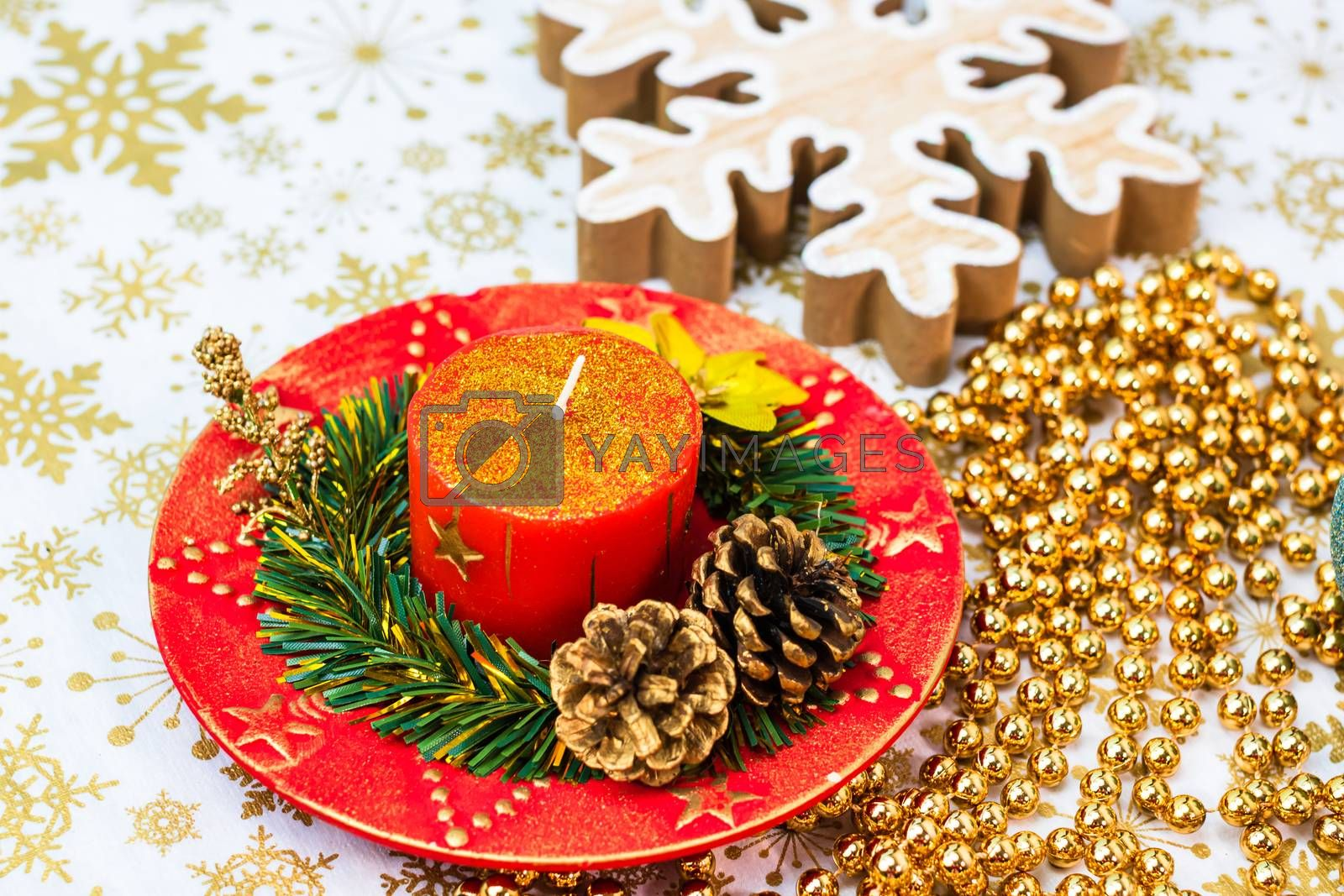 Close up of decorated christmas red candle isolated. Christmas composition with seasonal decorations and ornaments, colorful christmas background christmassy mood concept.