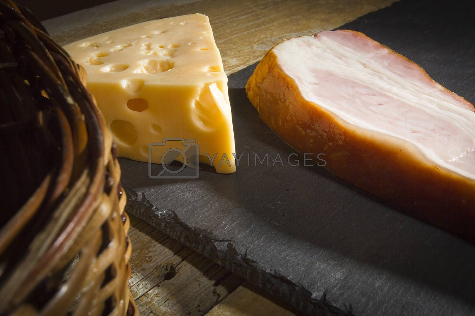 Cheese and bacon on a cutting stone board