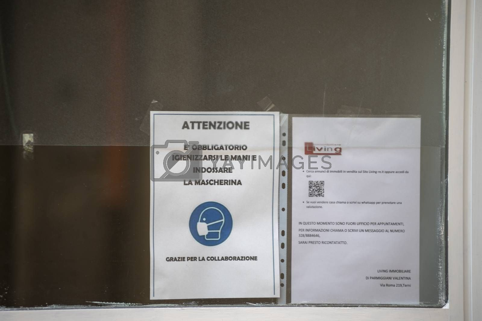 terni,italy november 11 2020:anti corona virus notice displayed in a shop