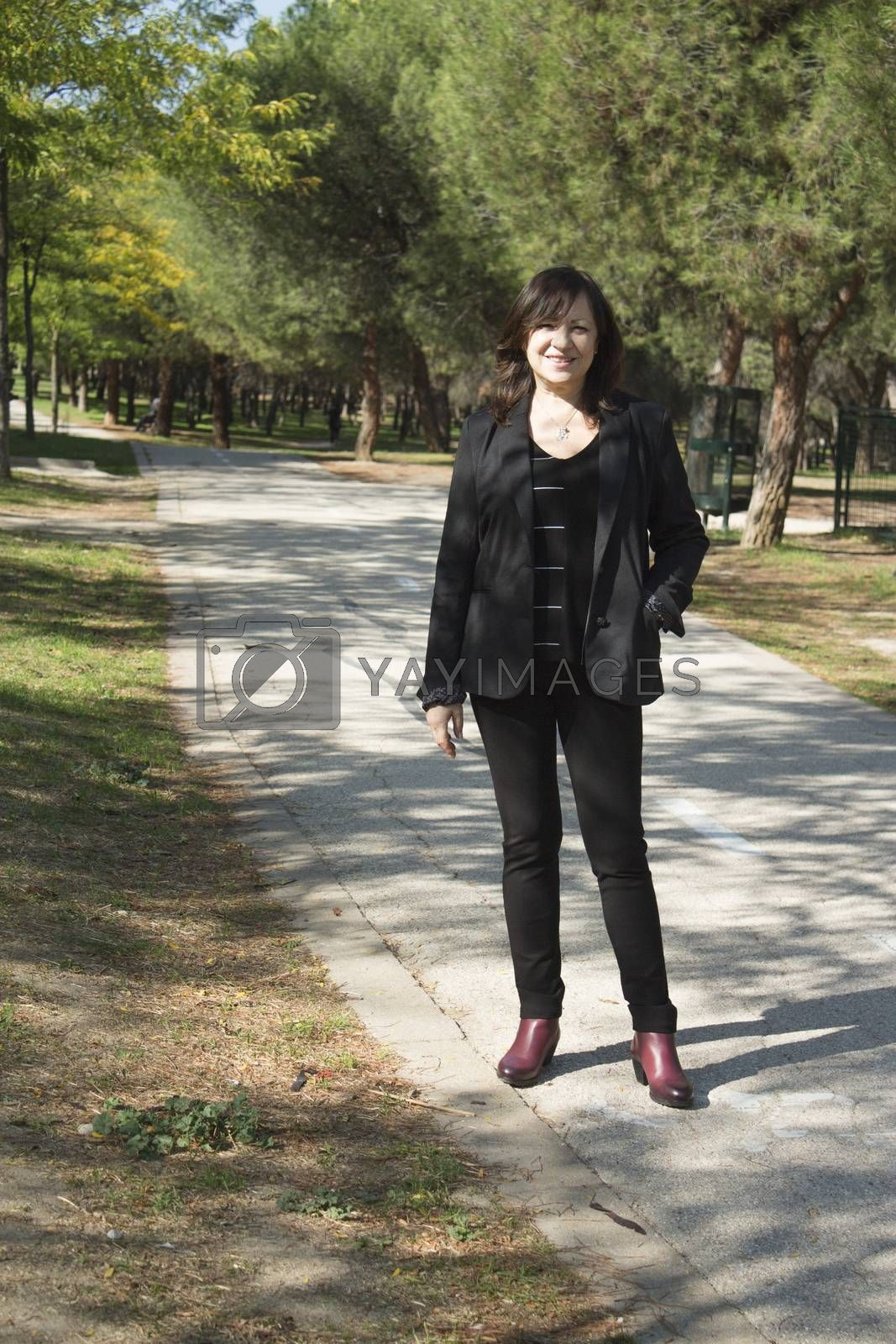Mature woman in positive attitude sitting and standing