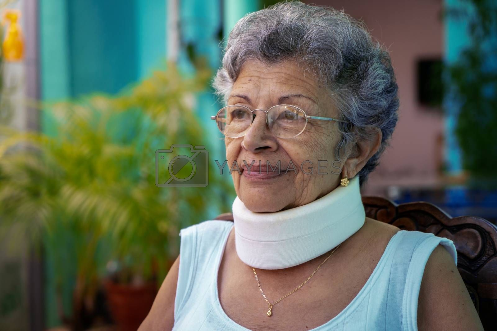 Elderly woman wearing homemade looking cervical immobilizer collar