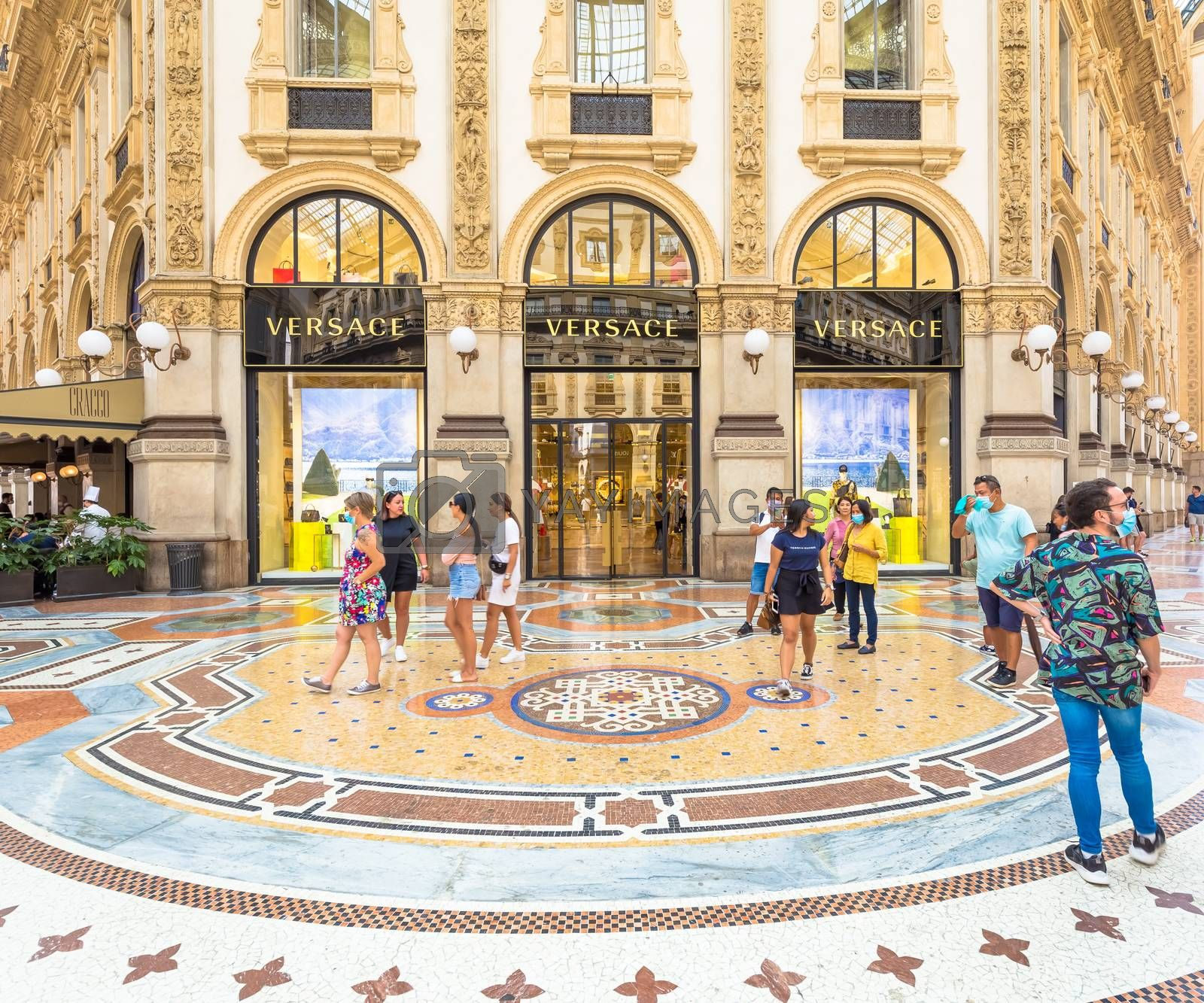 MILAN, ITALY - CIRCA SEPTEMBER 2020: Fashion shopping in Vittorio Emanuale's Gallery. People walking in front of a famous luxury boutique.