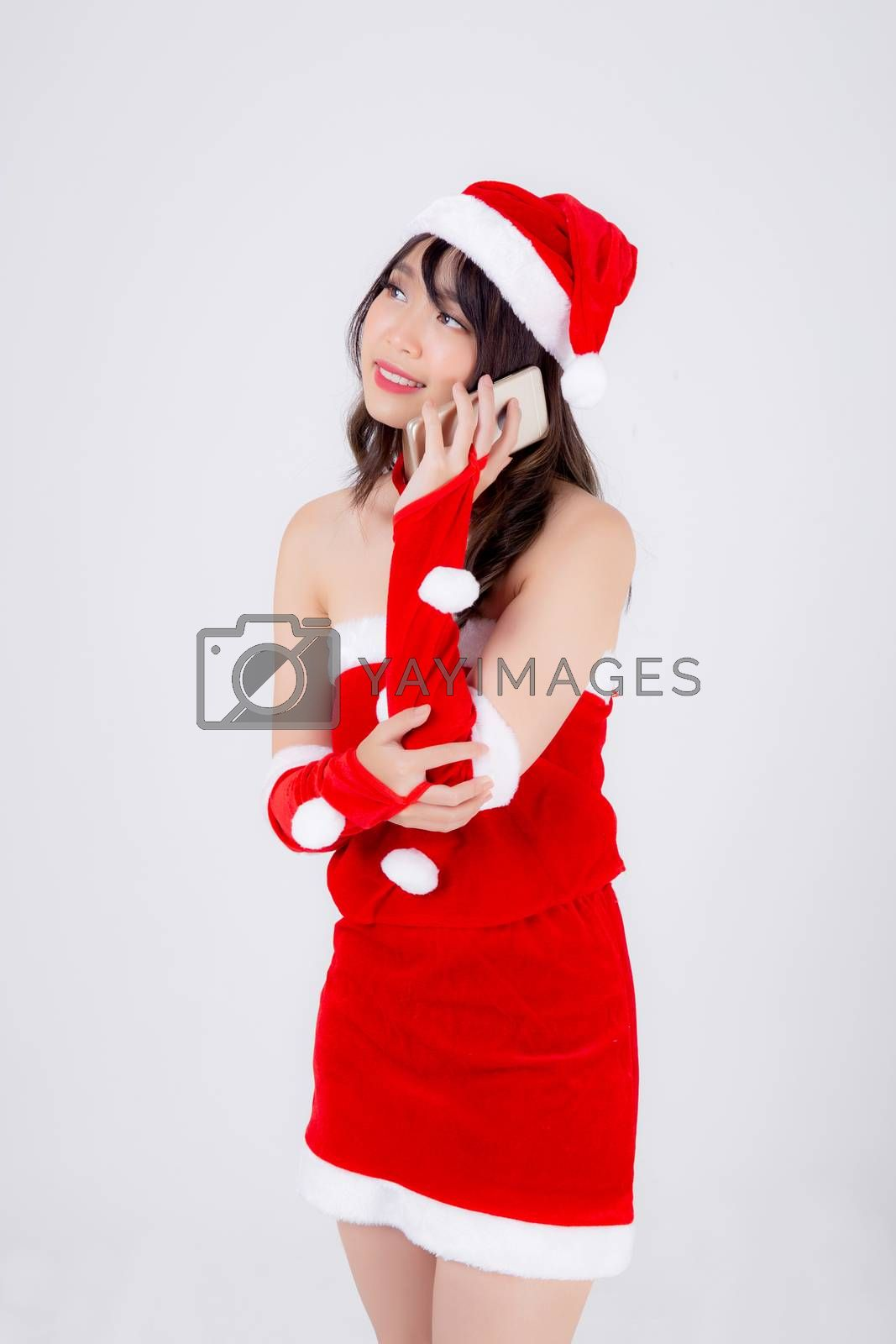 Beautiful portrait young asian woman in Santa talking smartphone in xmas day isolated on white background, asia girl speak and conversation with phone in Christmas holiday, communication concept.