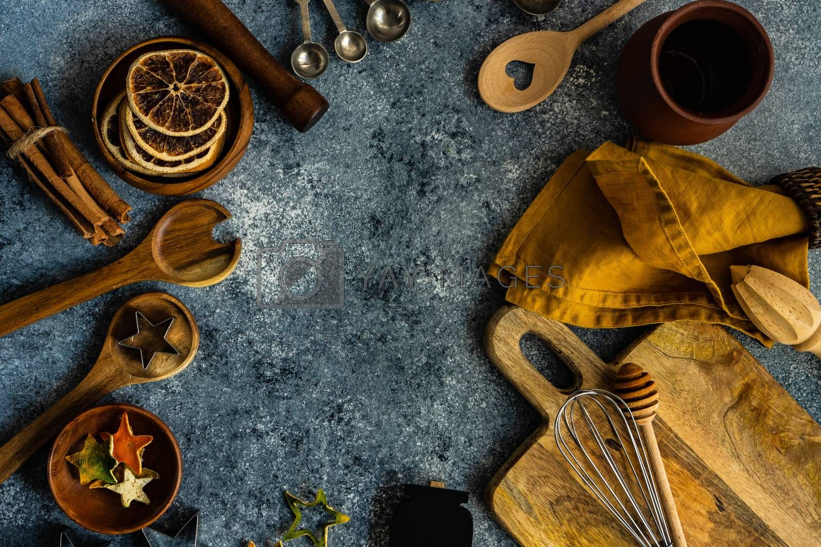 Cooking concept with kitchen tools on stone background with copy space