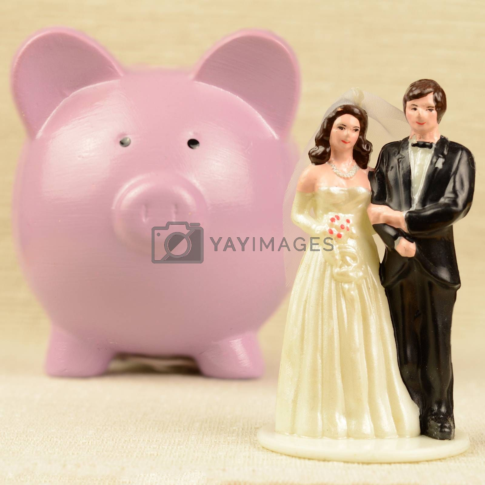 A conceptual image based on saving cash for the event of marriage.