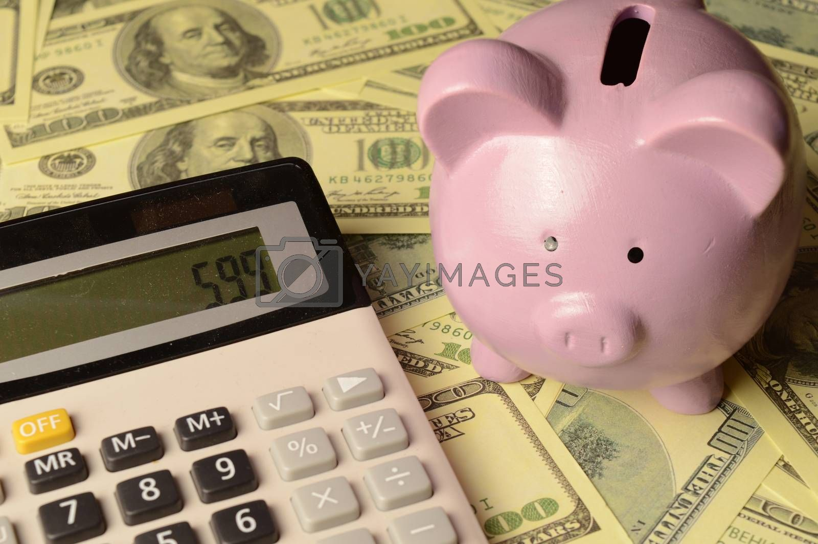 A theme based on financial calculations with the use of a piggy bank.